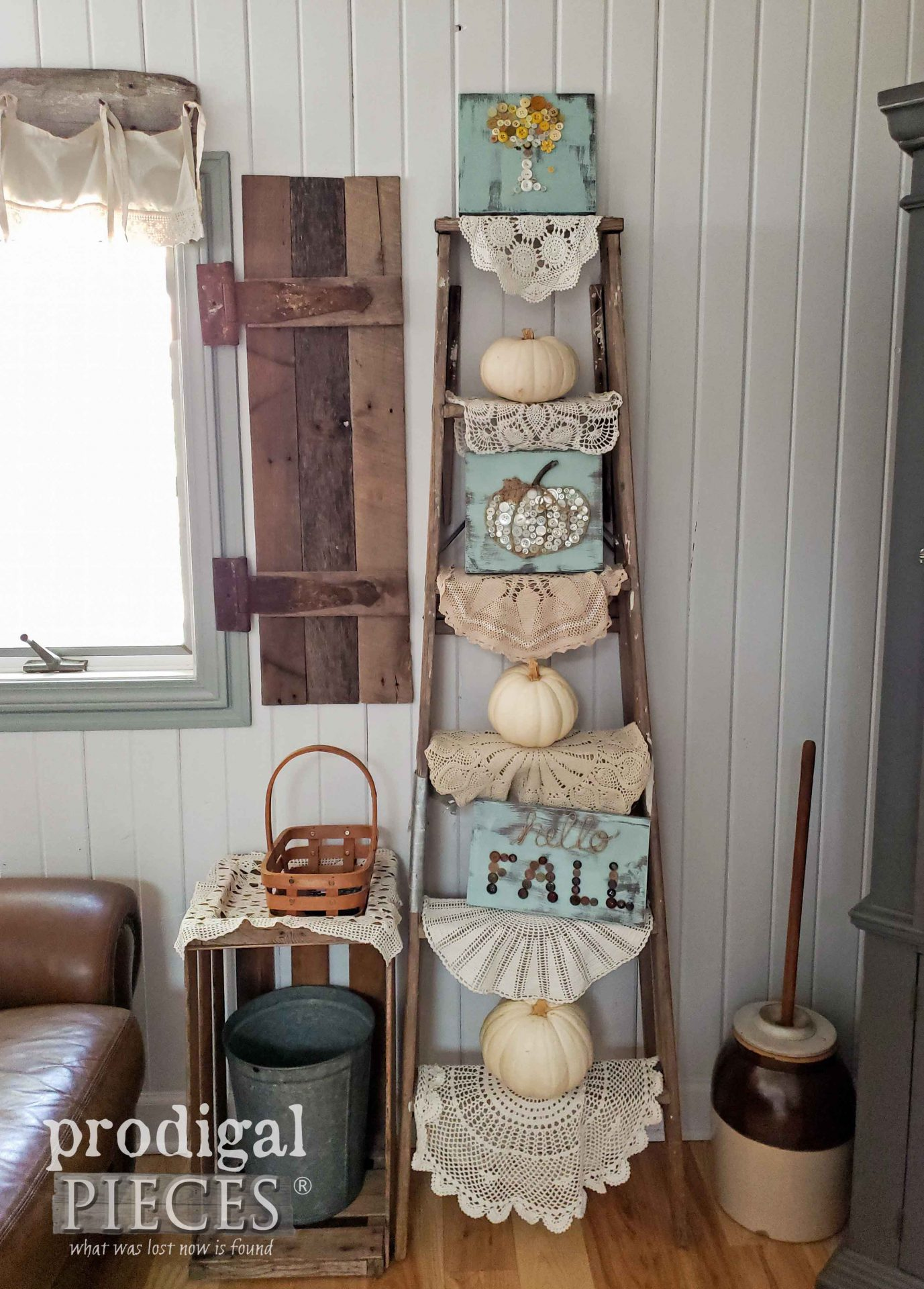 Old ladder filled with doilies, pumpkins, and button art created by Prodigal Pieces Kids CREATE | Video tutorial at prodigalpieces.com #prodigalpieces #diy #handmade #farmhouse #fall #home #homedecor #crafts