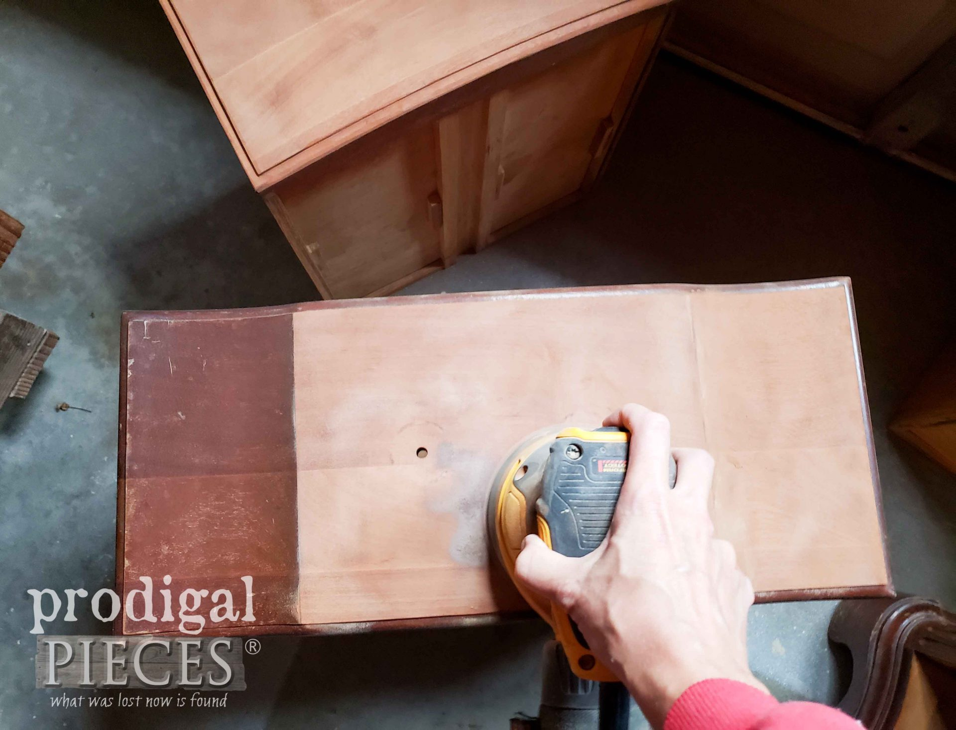 Sanding mahogany drawers on vintage serpentine dresser | prodigalpieces.com
