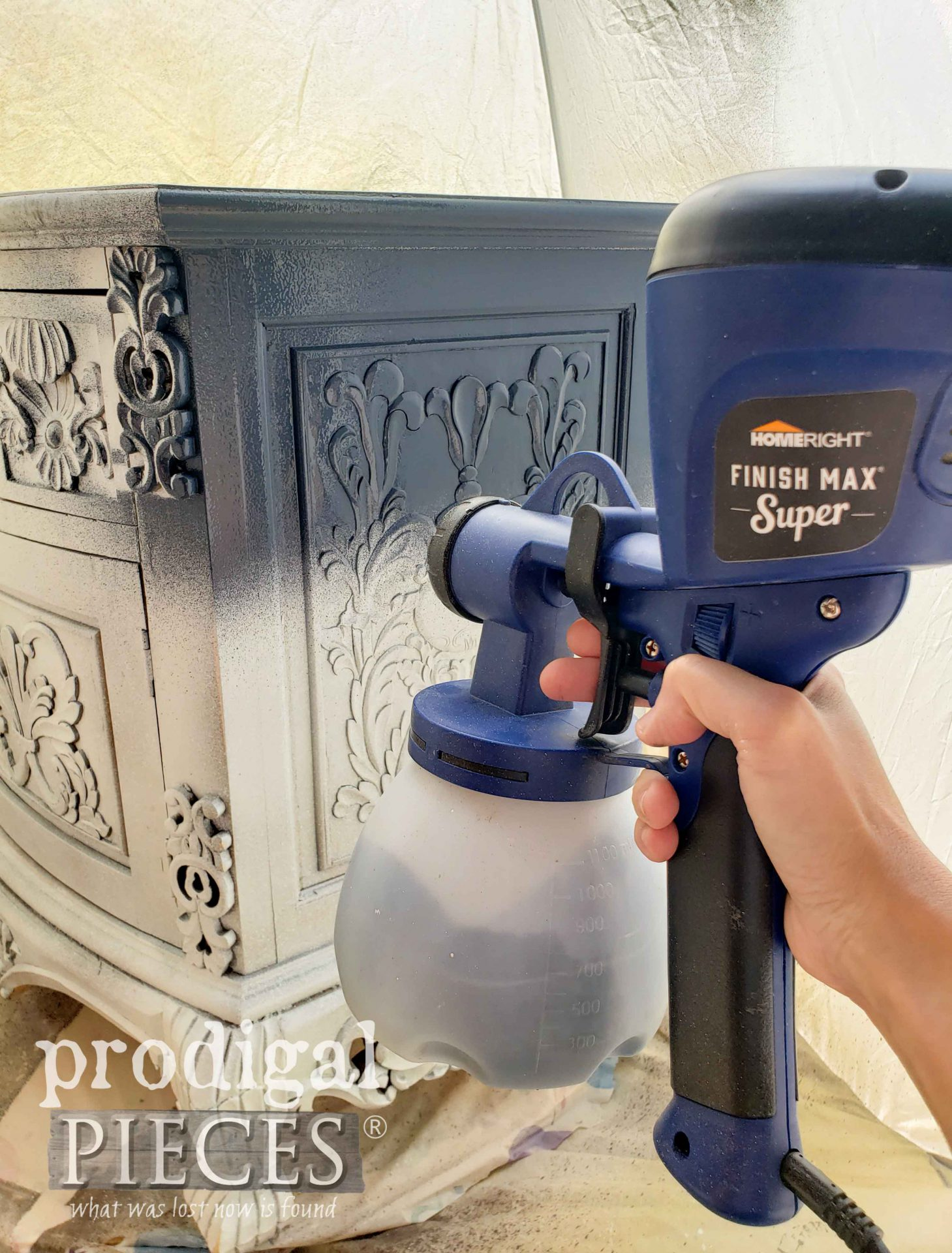 Spraying Navy Blue Paint onto Entertainment Stand with HomeRight Super Finish Max Extra | prodigalpieces.com #prodigalpieces