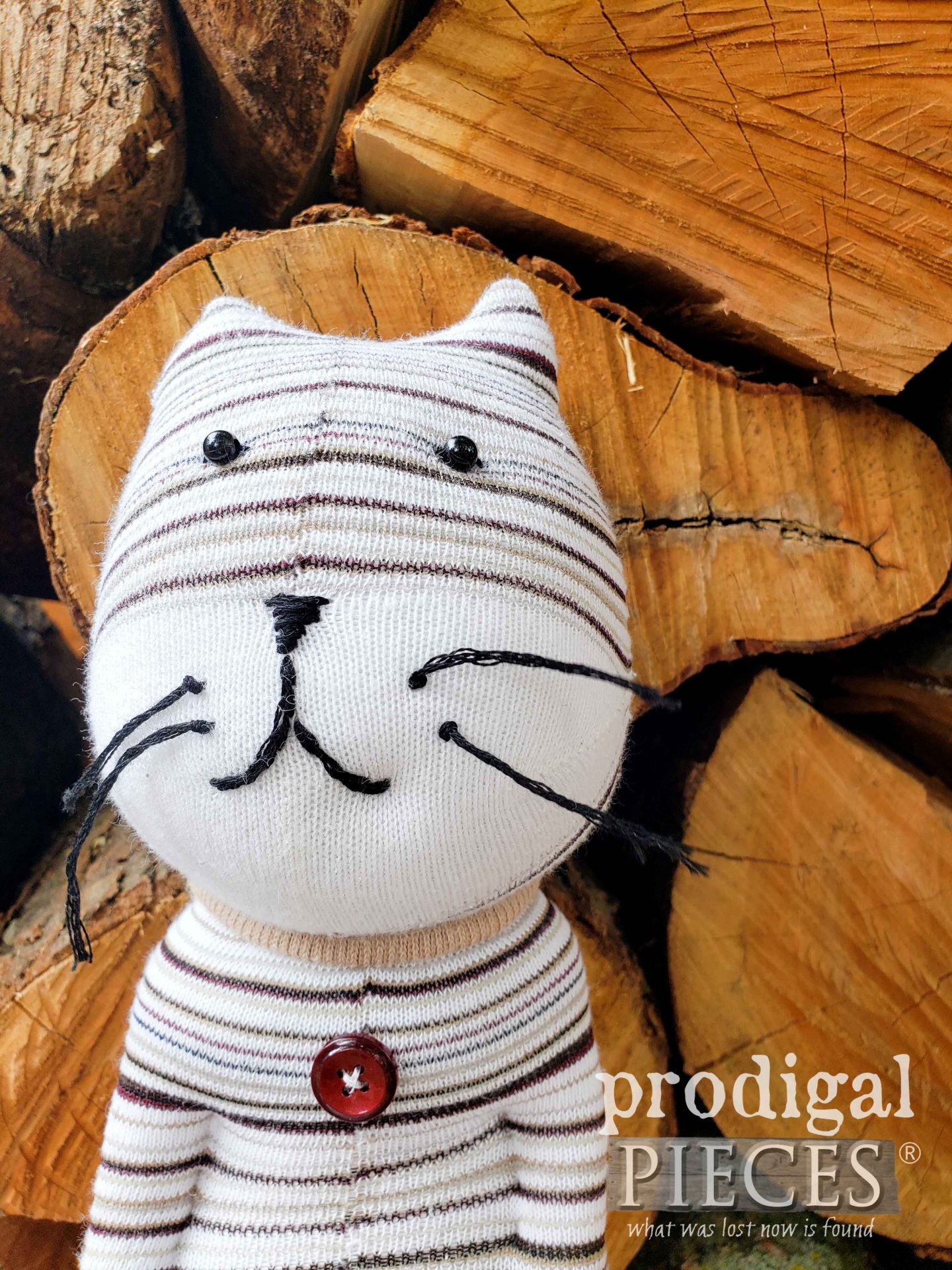 Handmade Embroidered Upcycled Sock Doll Cat by Larissa of Prodigal Pieces | prodigalpieces.com #prodigalpieces #handmade #toys #upcycled #cat #kids #sewing