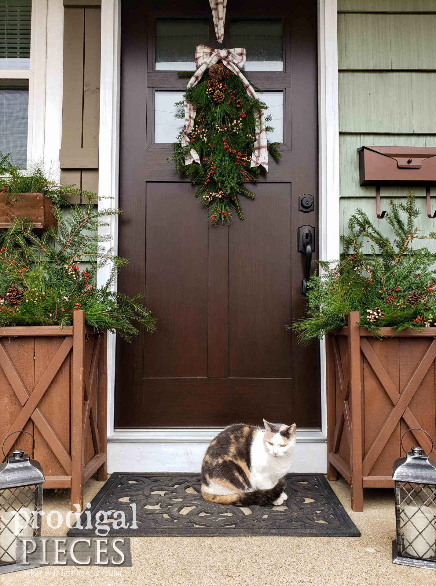 Farmhouse Christmas Front Door with Fresh Greens and Calico Cat | by Prodigal Pieces | prodigalpieces.com #prodigalpieces #entry #home #christmas #diy #homedecor #farmhouse #nordic #pets