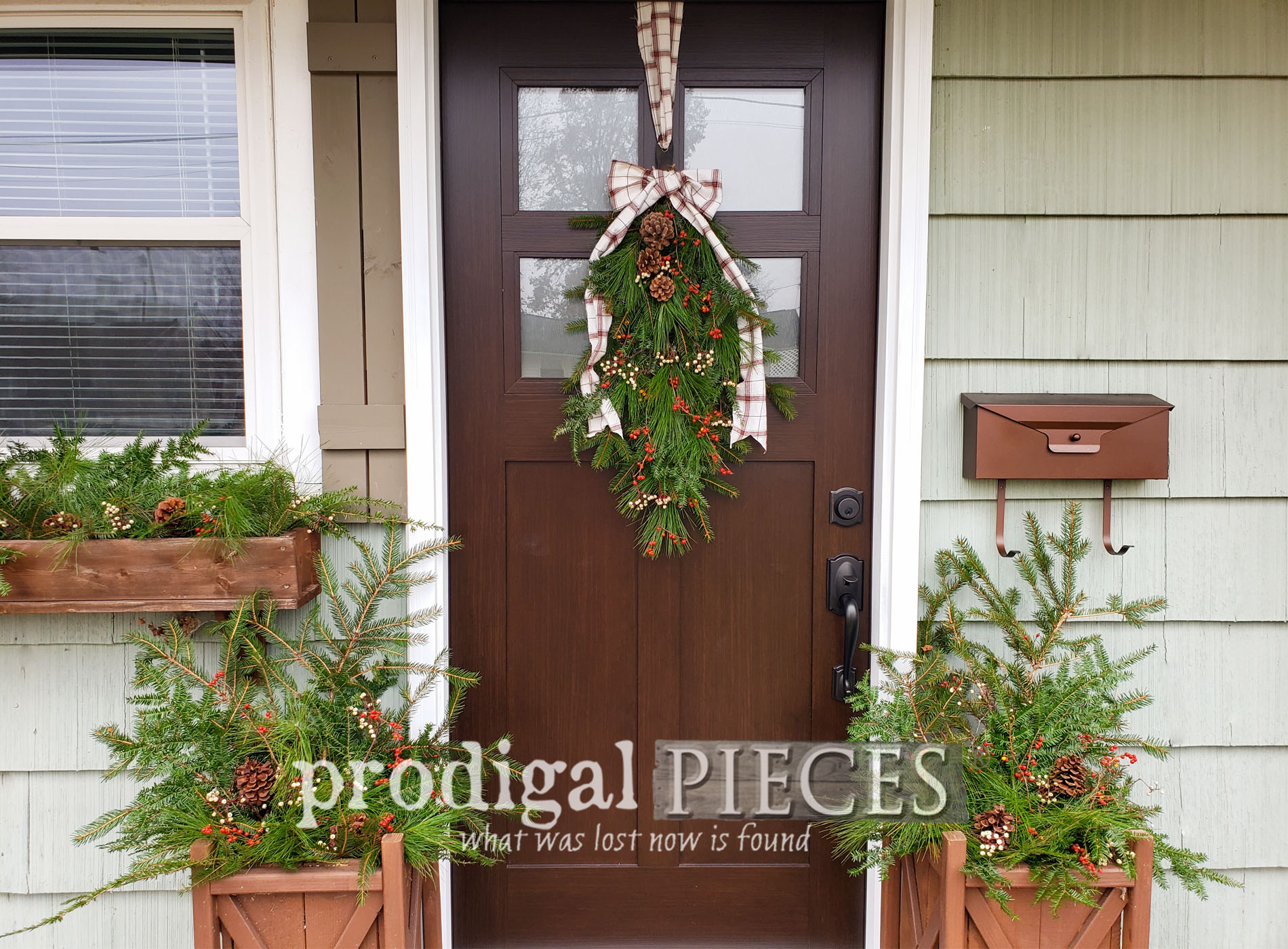 You can create this affordable DIY Christmas Swag and Planters from foraged greens | Easy, low-cost, & fun! Come see the video tutorial by Larissa at Prodigal Pieces | prodigalpieces.com #prodigalpieces #diy #home #holiday #christmas #homedecor #farmhouse #budgetfriendly