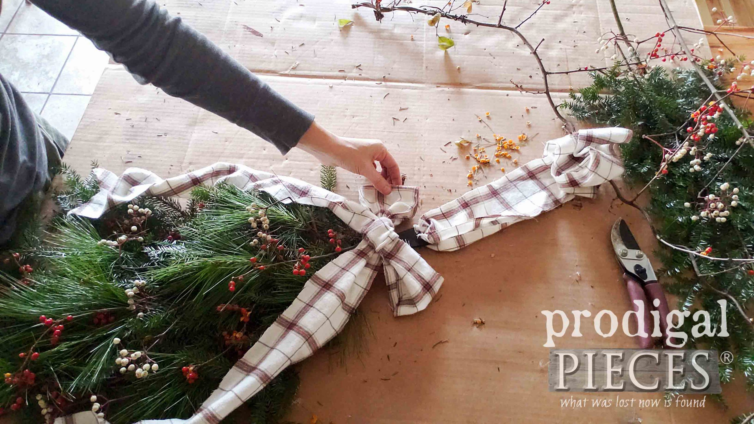 Flannel Bow Placement on DIY Christmas Swag | Video tutorial by Larissa of Prodigal Pieces | prodigalpieces.com