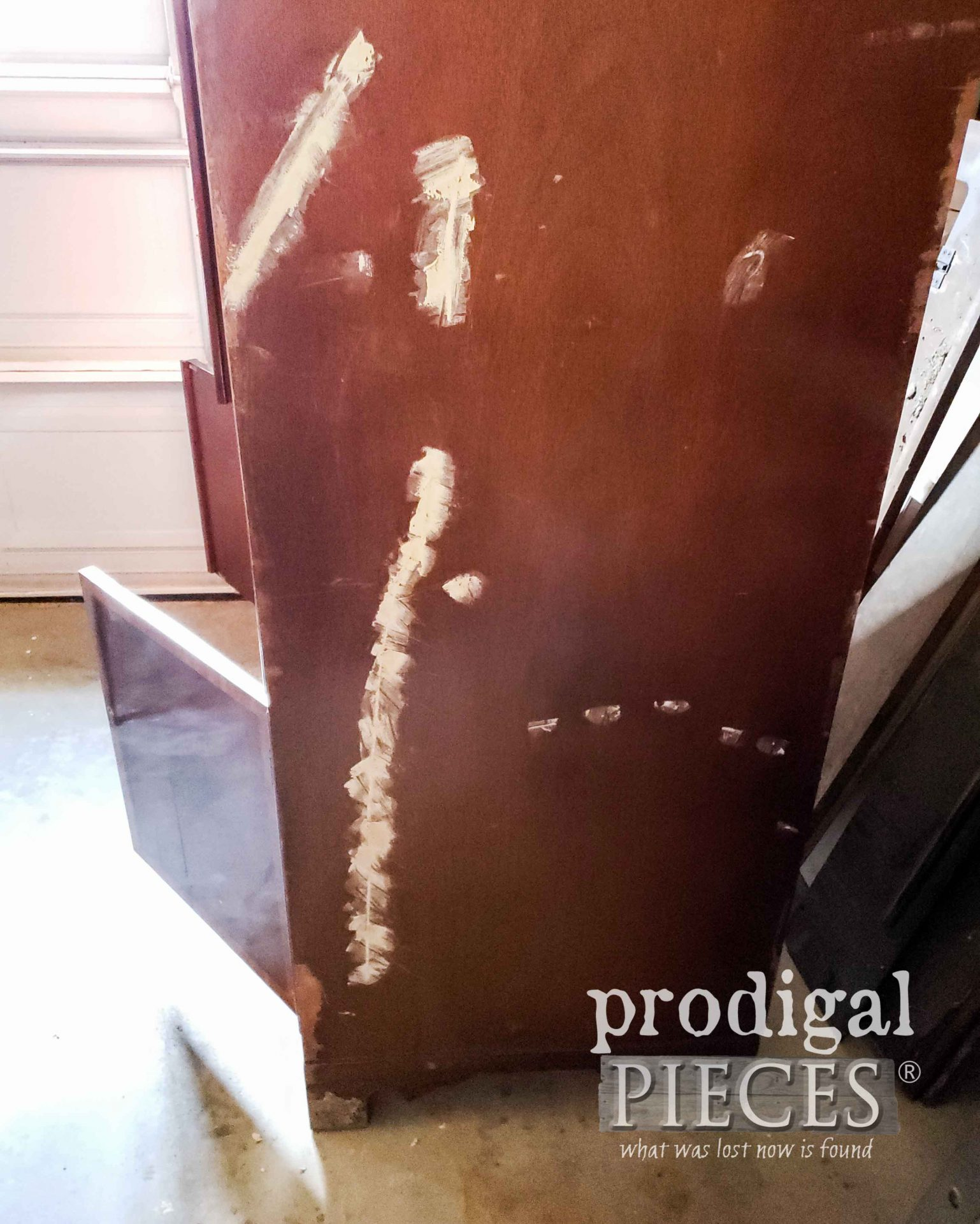 Wood Filler Spots on Upcycled Entertainment Center | prodigalpieces.com