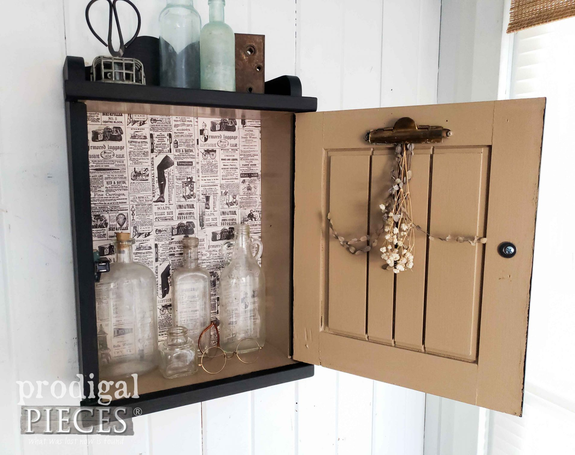 Open Vintage Apothecary Cabinet with Newspaper Decoupage by Larissa of Prodigal Pieces | prodigalpieces.com #prodigalpieces #diy #farmhouse #home #homedecor