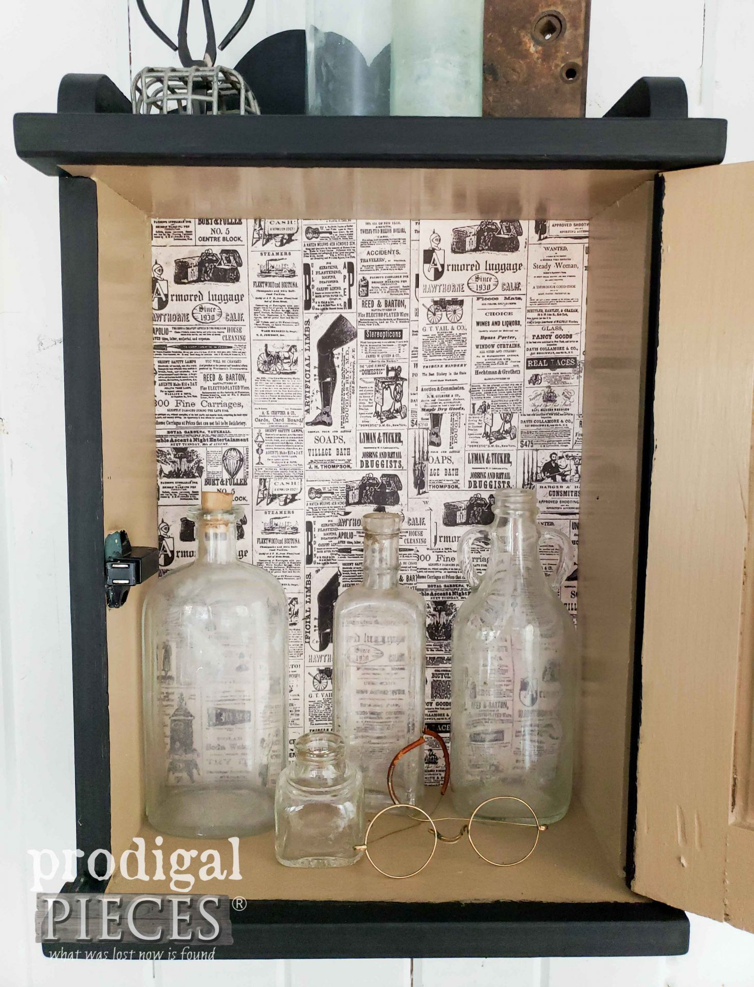 Vintage Newspaper Print Lined Vintage Apothecary Cabinet by Larissa of Prodigal Pieces | prodigalpieces.com #prodigalpieces #diy #vintage #home #farmhouse #homedecor