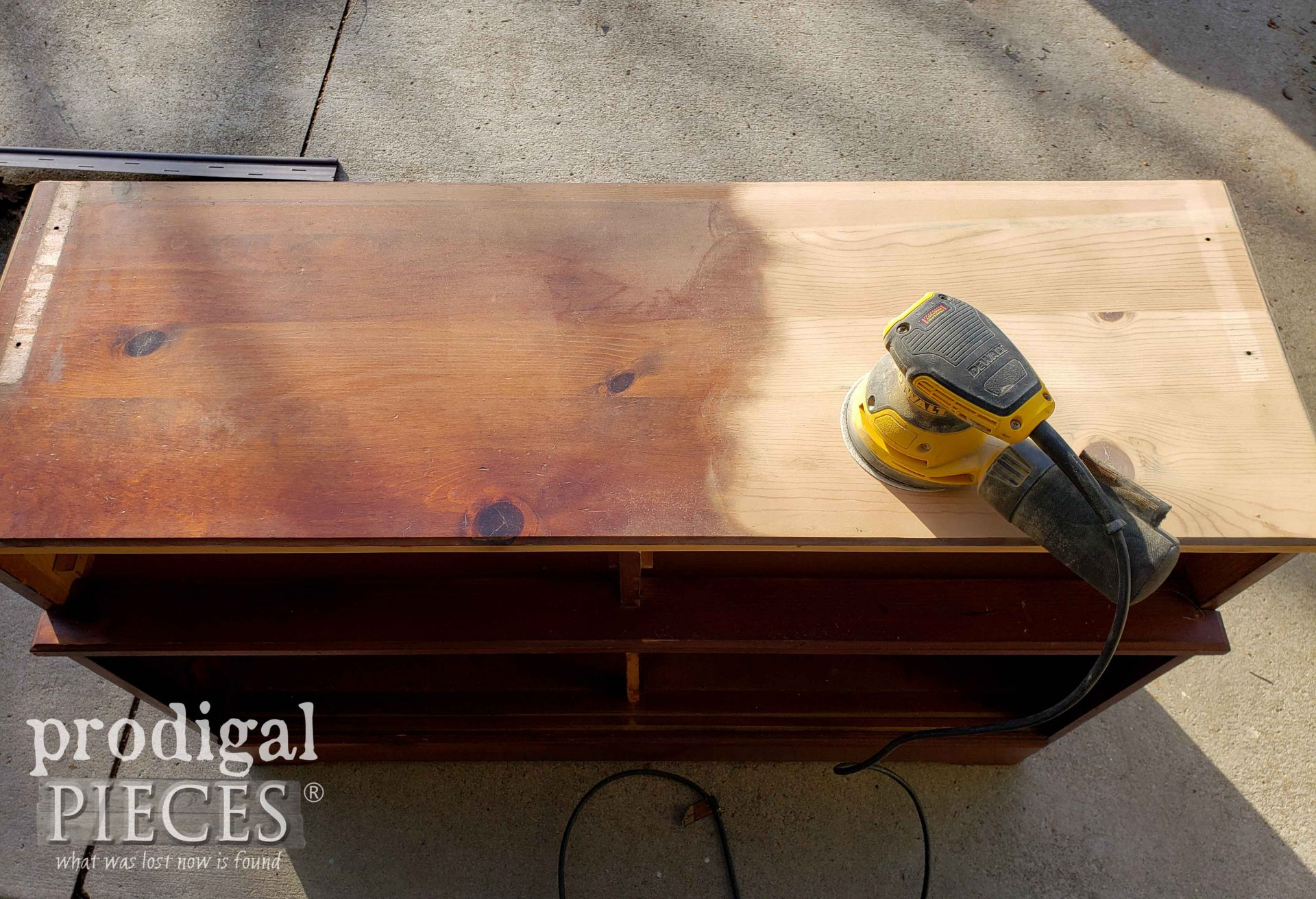 Sanding Top of Farmhouse Hutch for a Fresh New Look | prodigalpieces.com