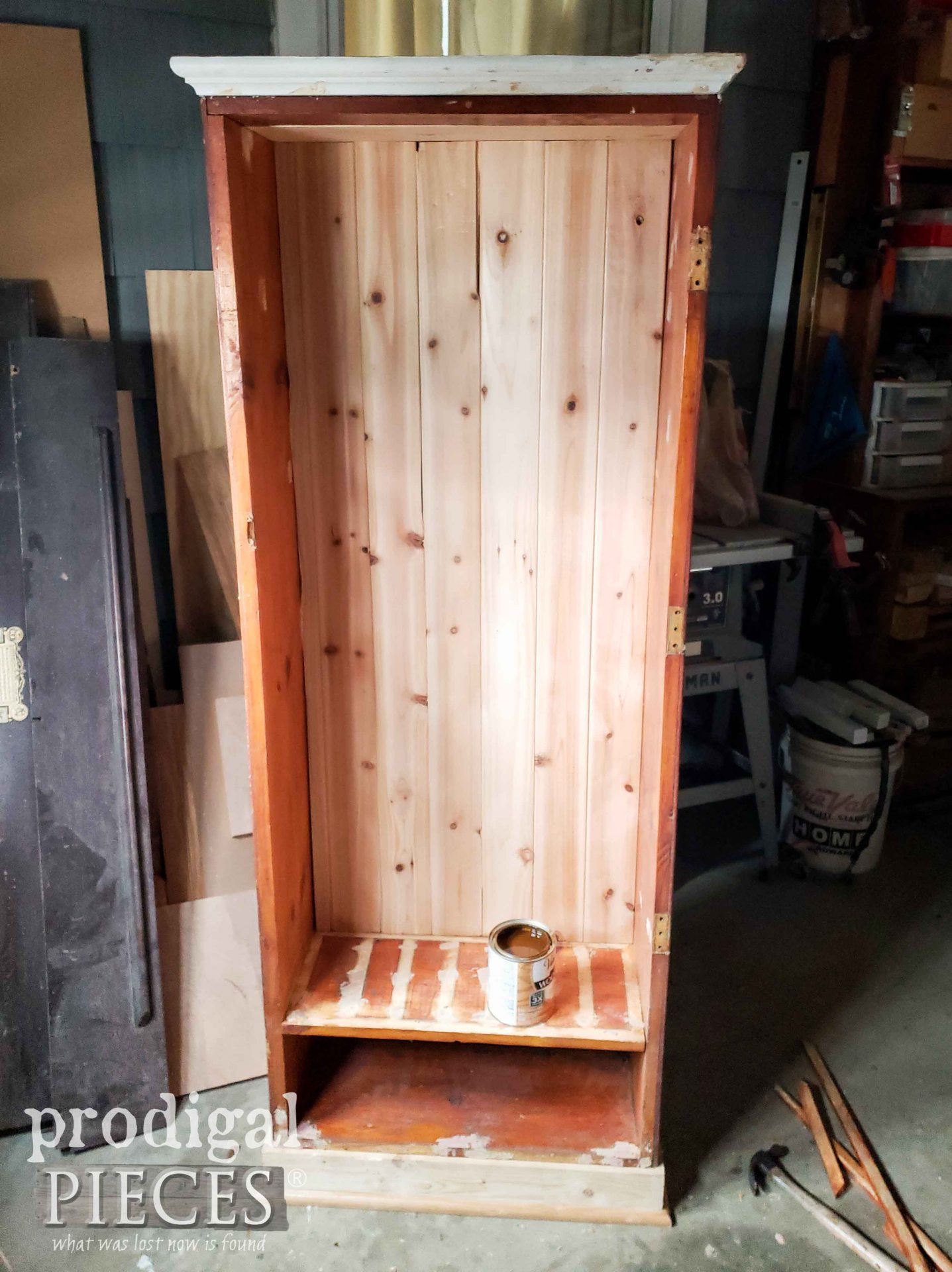 Refreshed Gun Cabinet with Base, Moulding, and Paneling | prodigalpieces.com