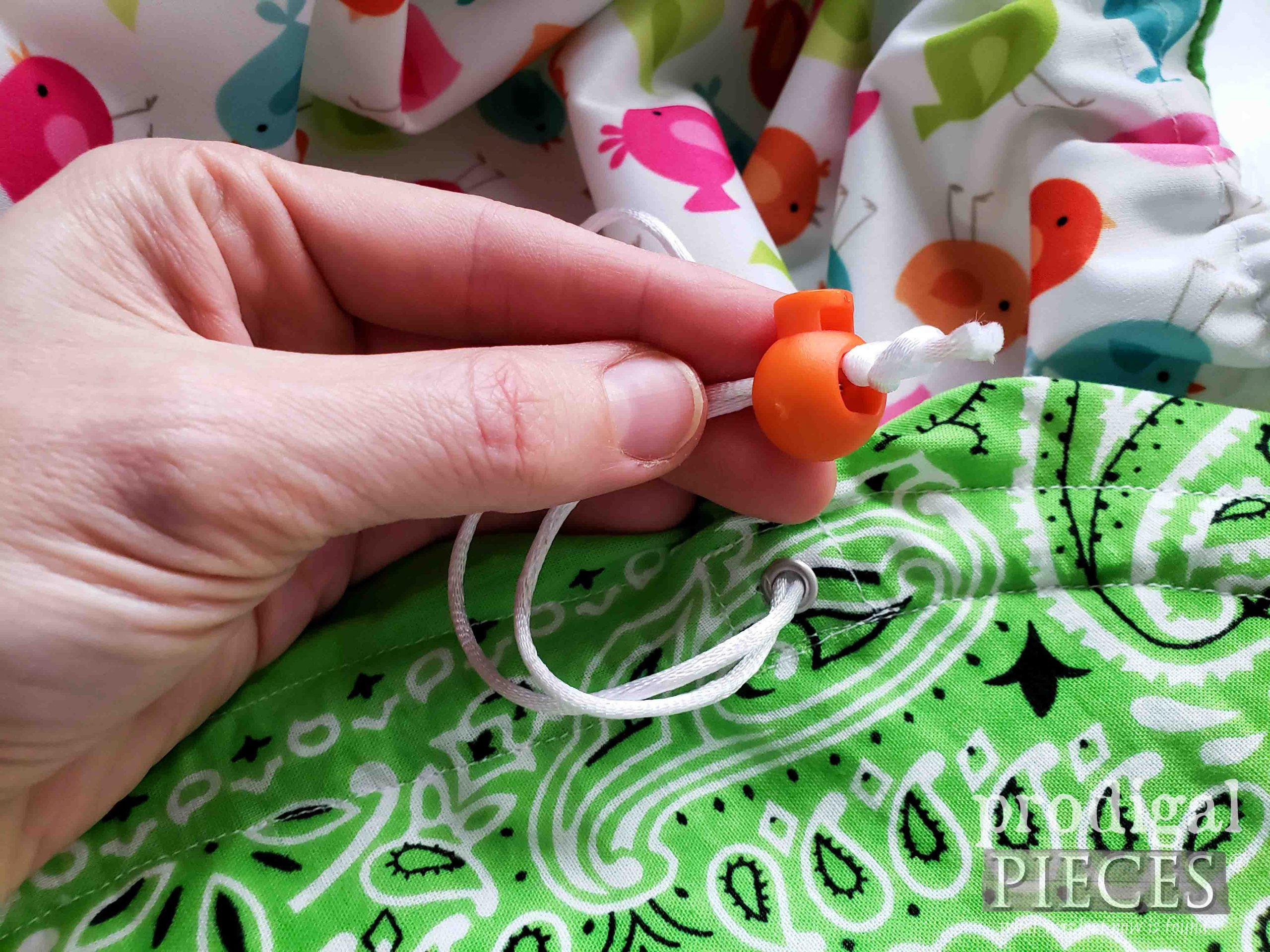 Adding Cord Stop to Circle Drawstring Bag   prodigalpieces.com