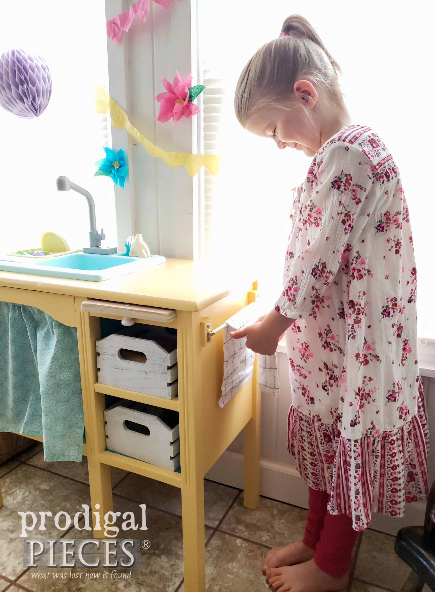 Girl Drying Hands on Play Kitchen Towel by Larissa Prodigal Pieces | prodigalpieces.com #prodigalpieces #kids #toys #kitchen