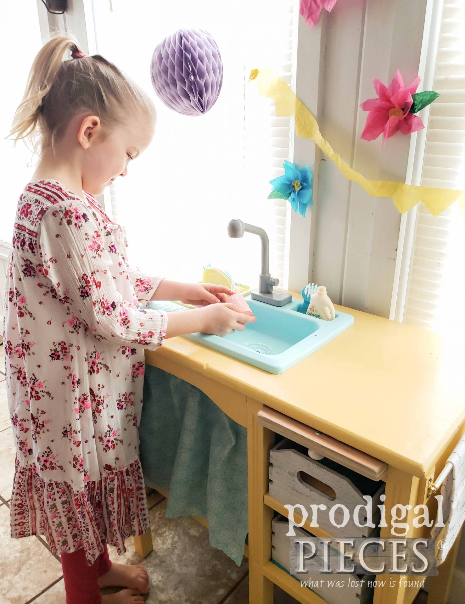 Girl Washing Dishes in Working Upcycled Play Kitchen by Larissa of Prodigal Pieces | prodigalpieces.com #prodigalpieces #diy #fun #kids #play