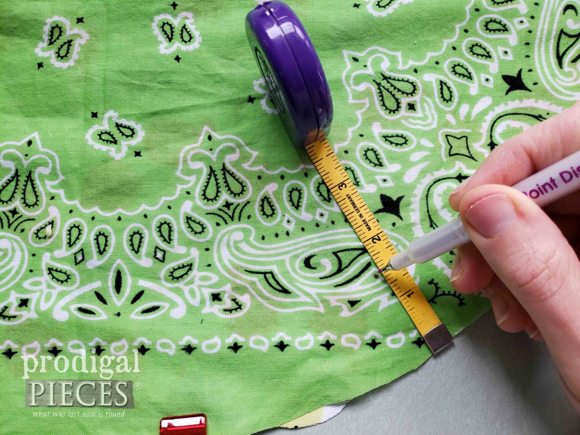 Measuring for Grommet on DIY Upcycled Bandana Drawstring Bag | prodigalpieces.com