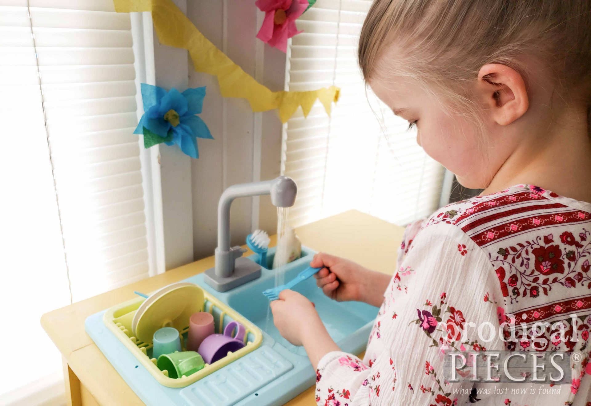 Pretend Play Washing Dishes in Upcycled Play Kitchen | prodigalpieces.com #prodigalpieces #upcycled #fun #play #kids