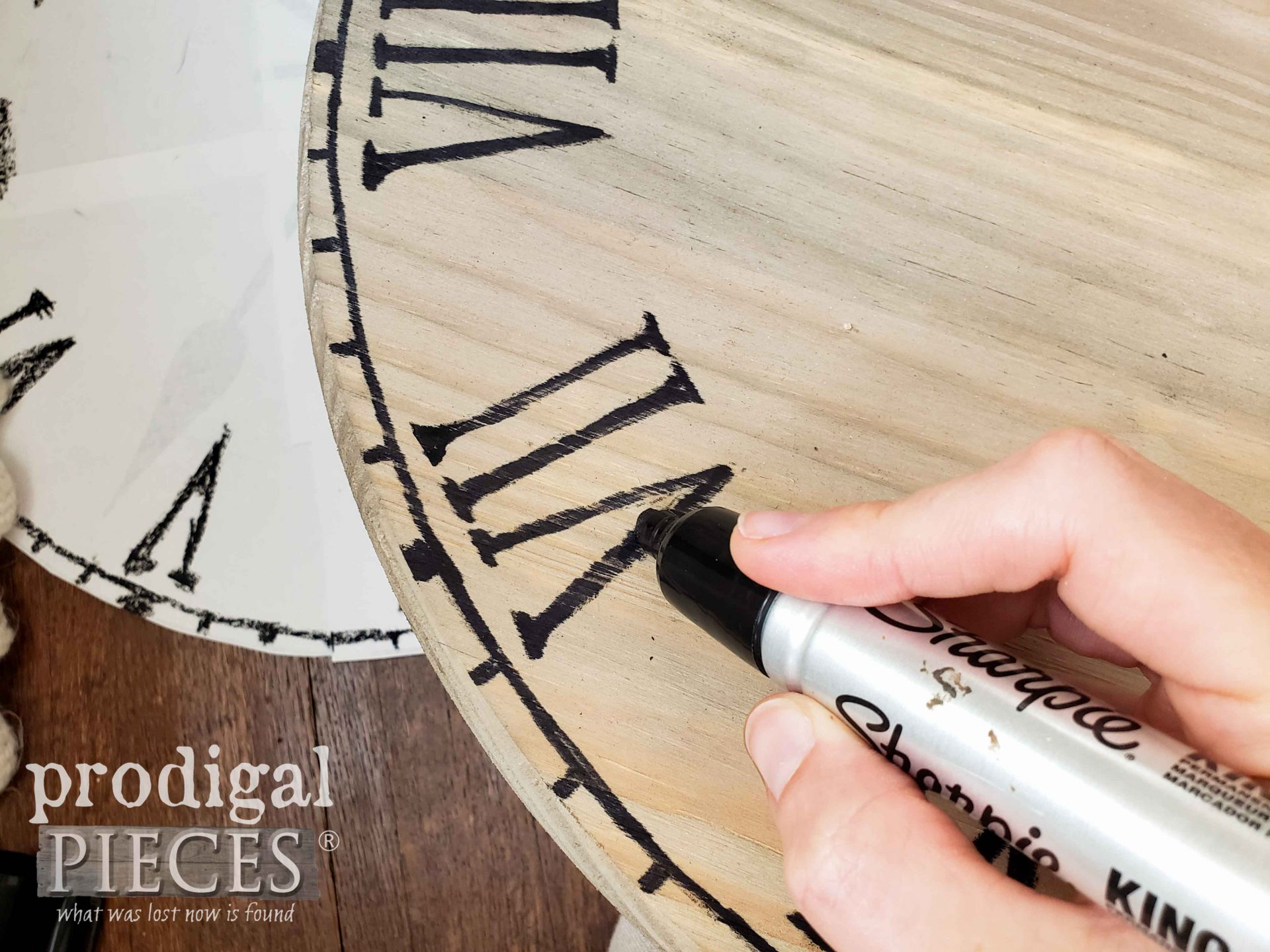 Filling in Roman Numerals on Upcycled Clock Face Table by Larissa of Prodigal Pieces | prodigalpieces.com