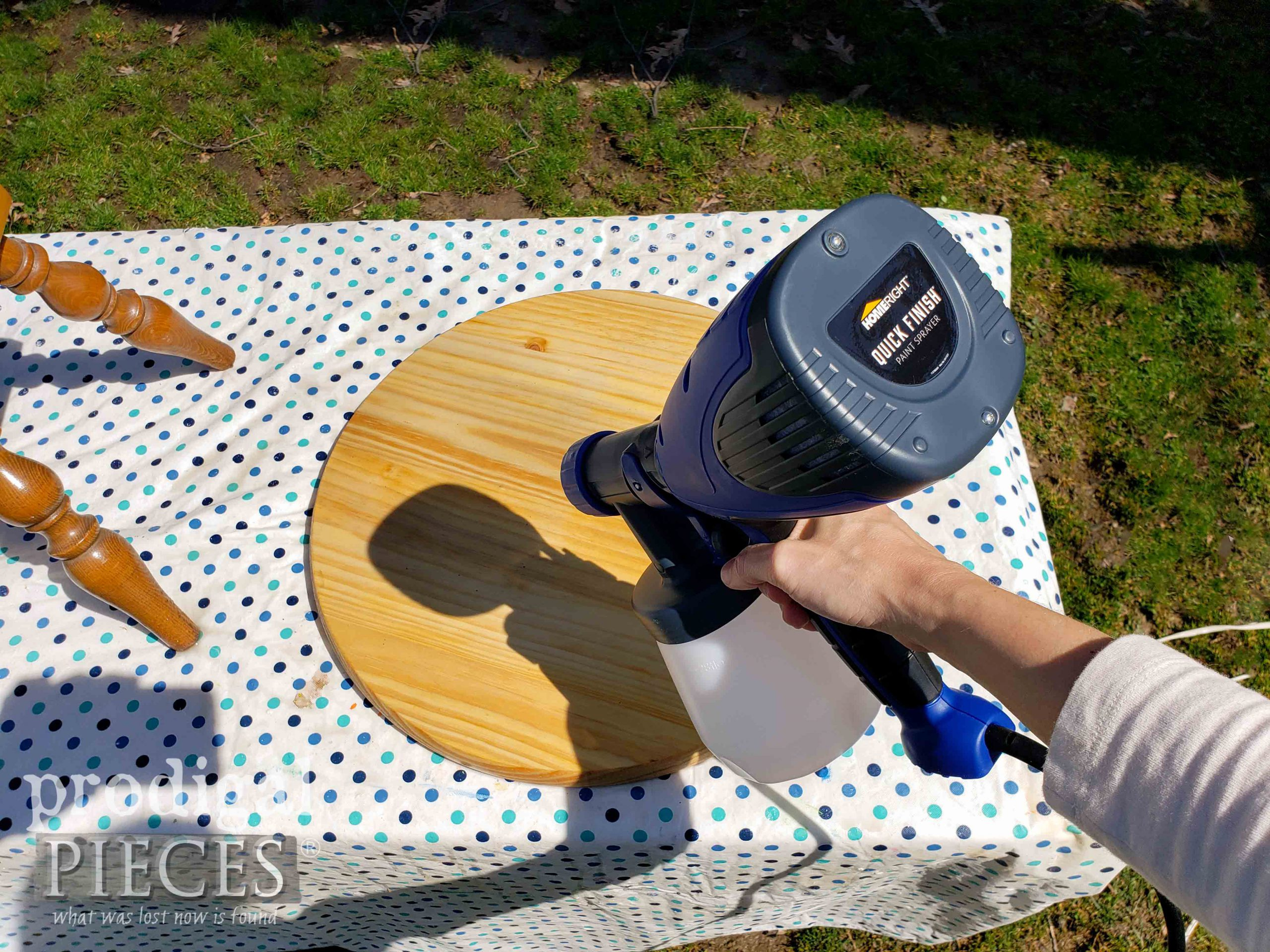 Spraying Natural Stain to Upcycled Clock Face Table Top by Prodigal Pieces | prodigalpieces.com