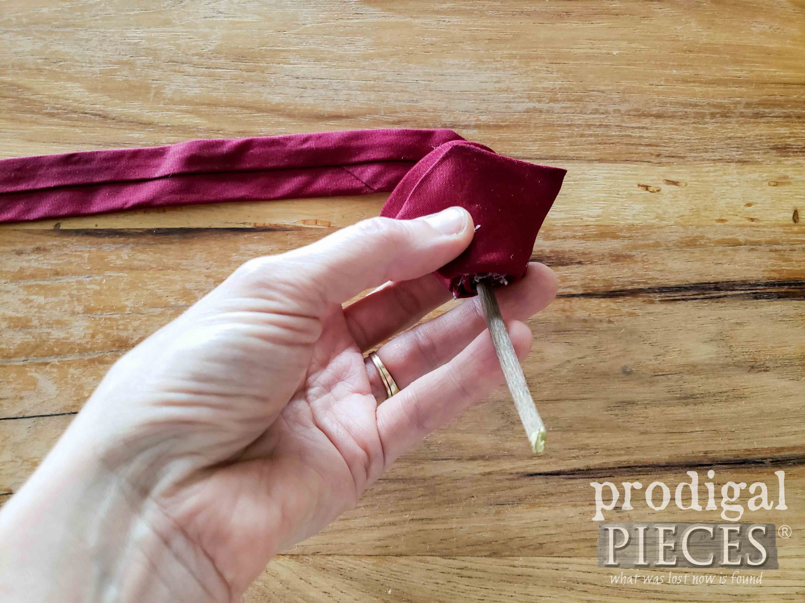 Adding Rosebud Stem to Upcycled Necktie Boutonniere by Larissa of Prodigal Pieces | prodigalpieces.com