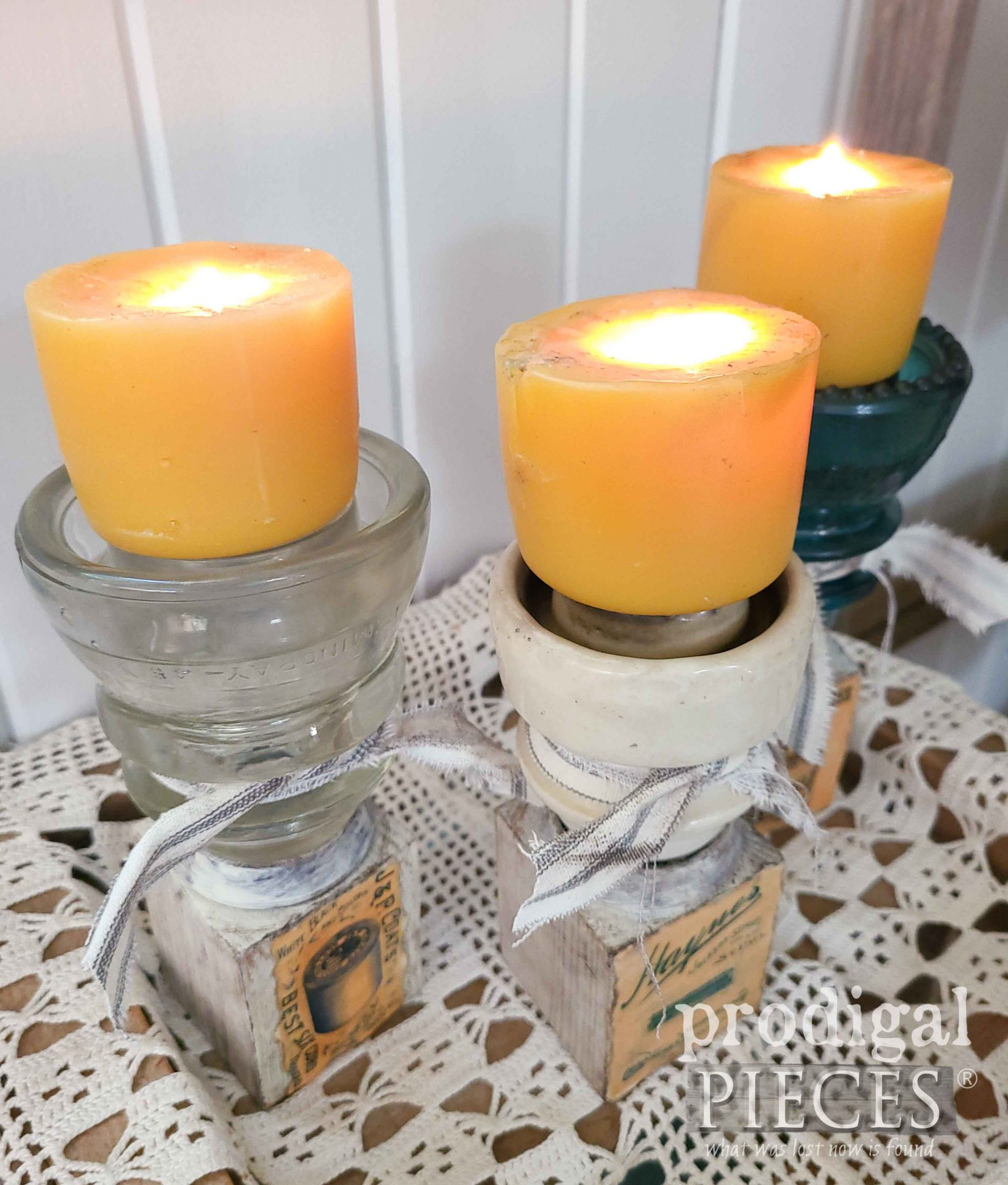 Lit Upcycled Antique Insulator Candle Holders with Handmade Beeswax Candles by Larissa of Prodigal Pieces | prodigalpieces.com #prodigalpieces #handmade #candles #farmhouse #home