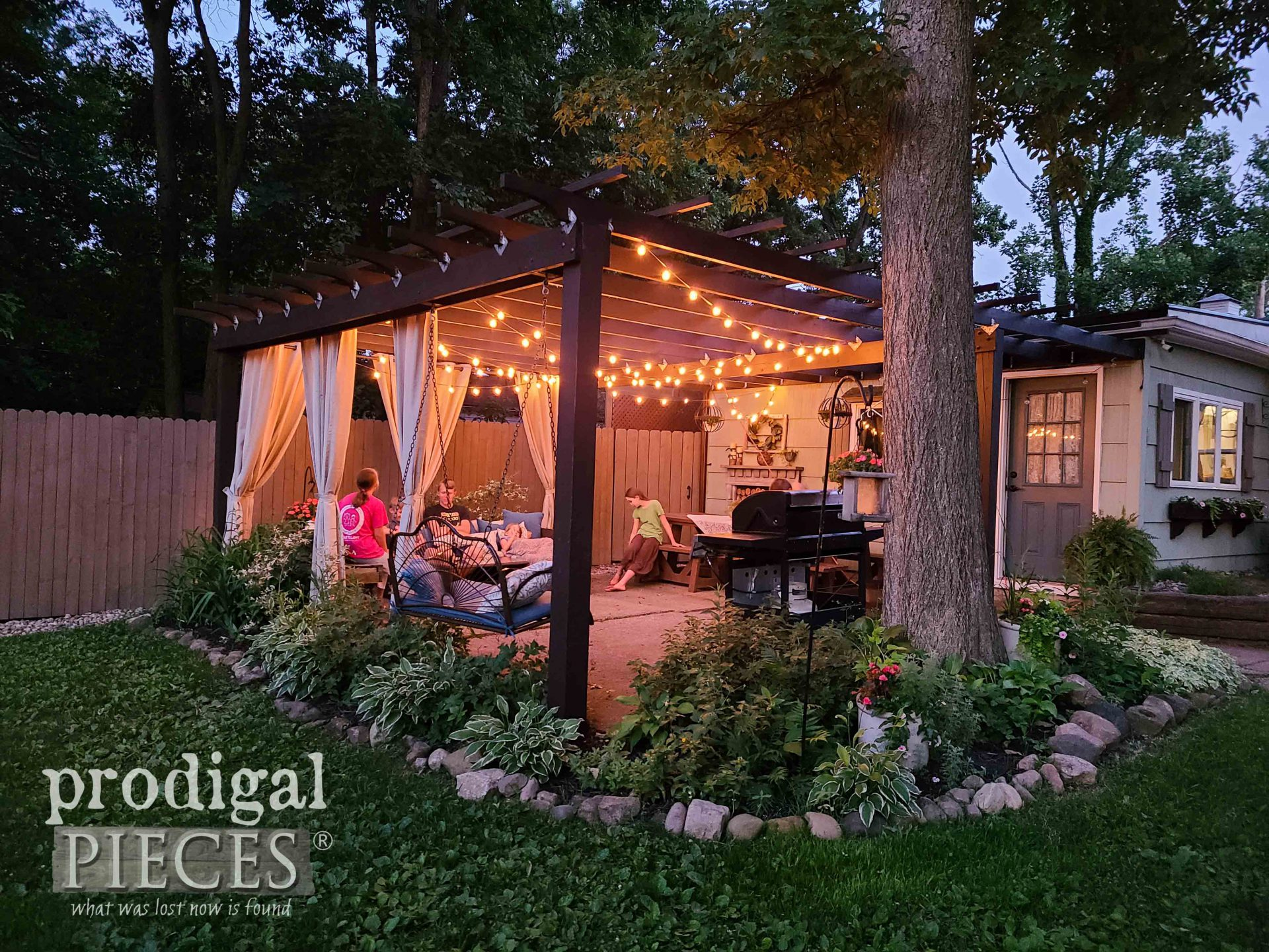 Nighttime Cafe Lights on Patio with Pergola by Prodigal Pieces | prodigalpieces.com #prodigalpieces #diy #home #homedecor #patio #outdoor