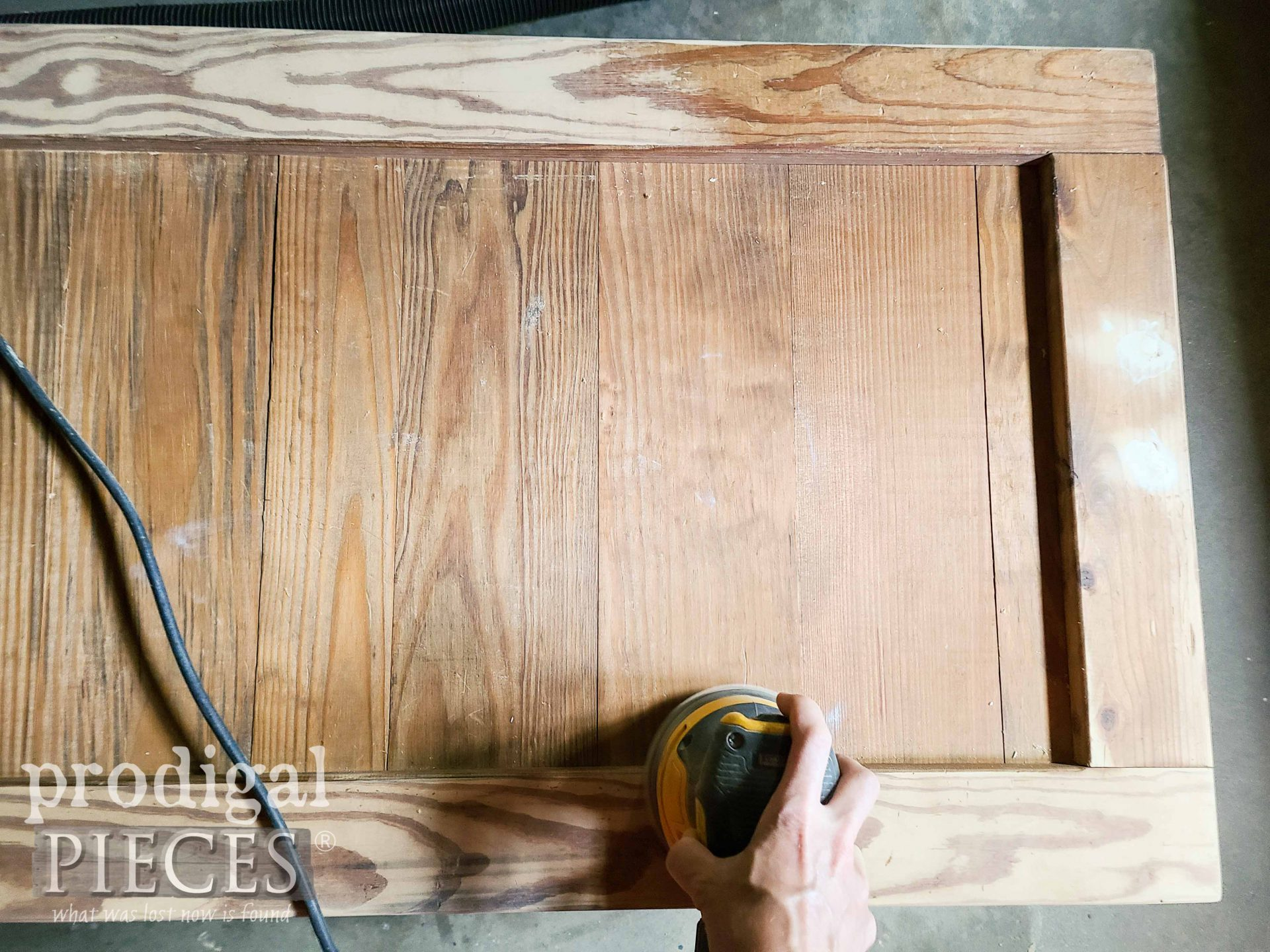 Sanding Upcycled Coffee Table Top | prodigalpieces.com #prodigalpieces