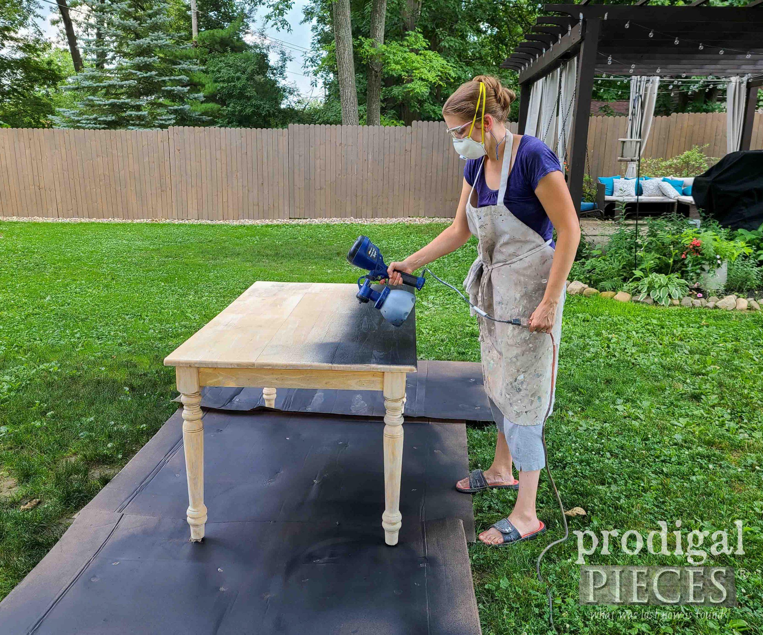 Larissa of Prodigal Pieces Spray Painting Farmhouse Dining Table | prodigalpieces.com #prodigalpieces #furniture #diy #farmhouse