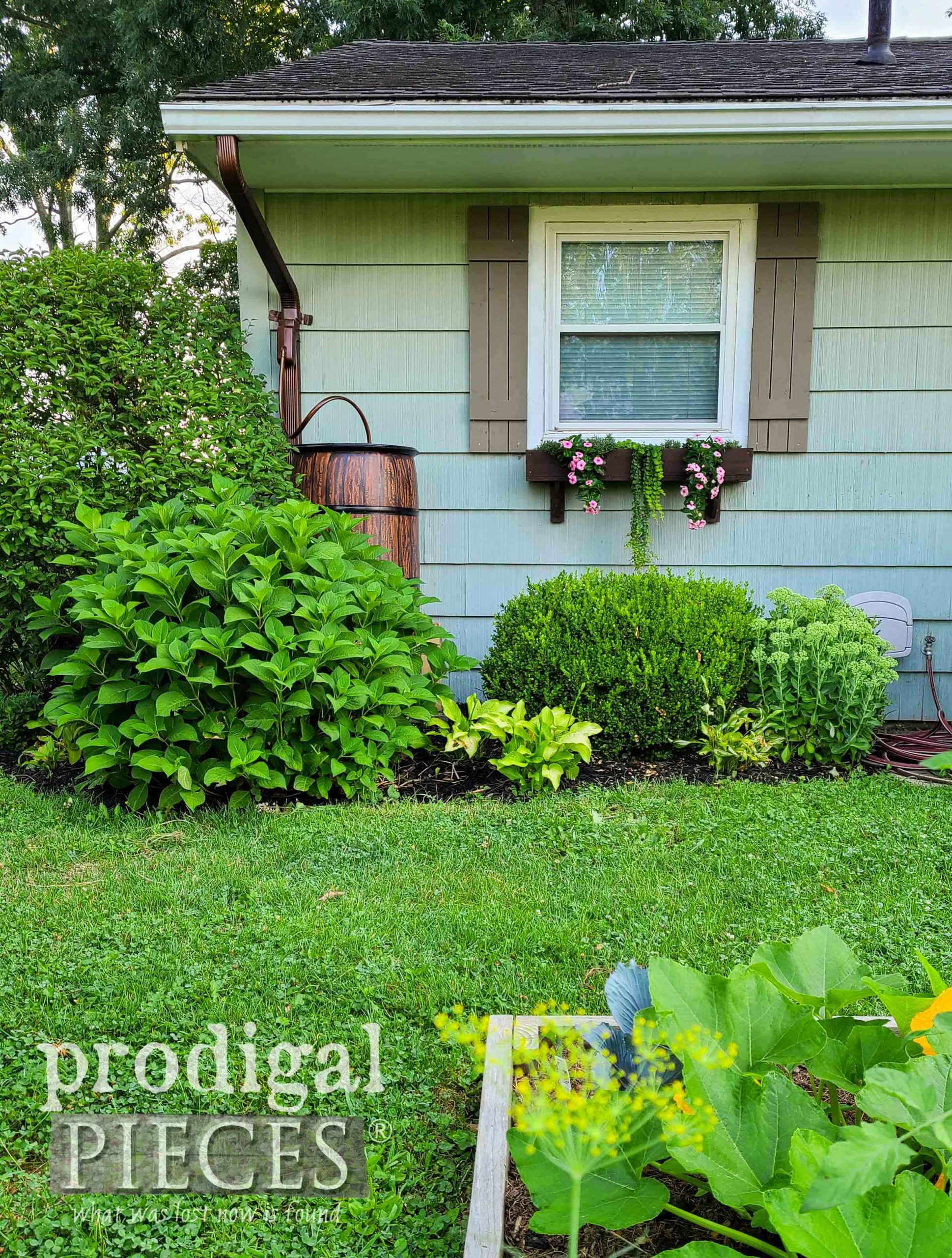 DIY Gardening with Raised Beds and Rain Barrel by Larissa of Prodigal Pieces | prodigalpieces.com #prodigalpieces #diy #garden #selfsufficient #home