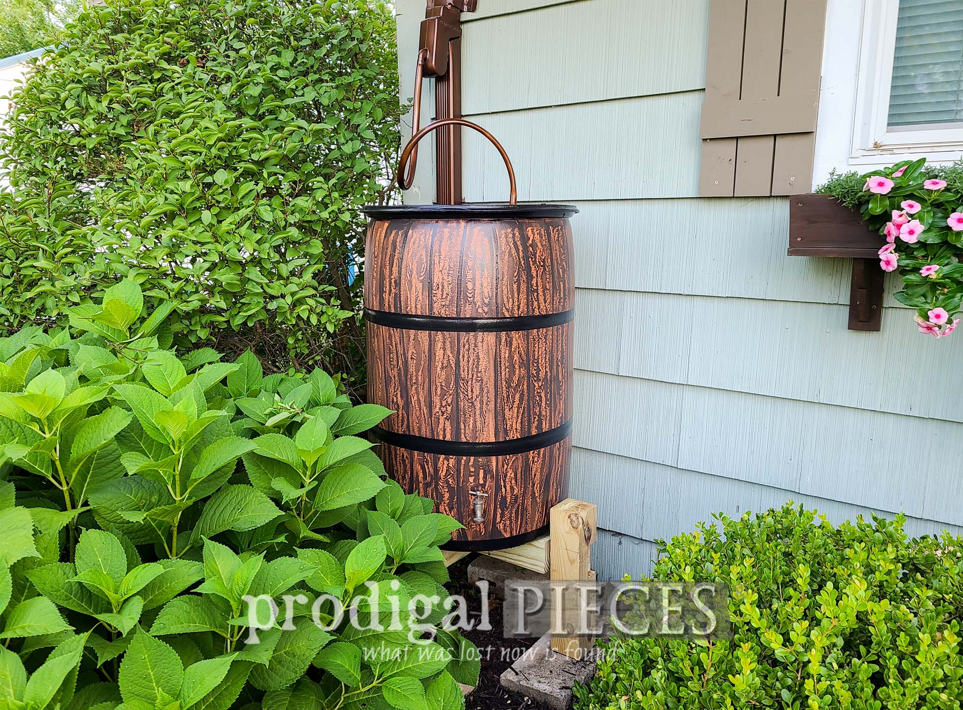 Featured DIY Rain Barrel with Faux Wood Grain by Larissa of Prodigal Pieces | prodigalpieces.com #prodigalpieces #diy #home #garden #homestead #selfsufficient