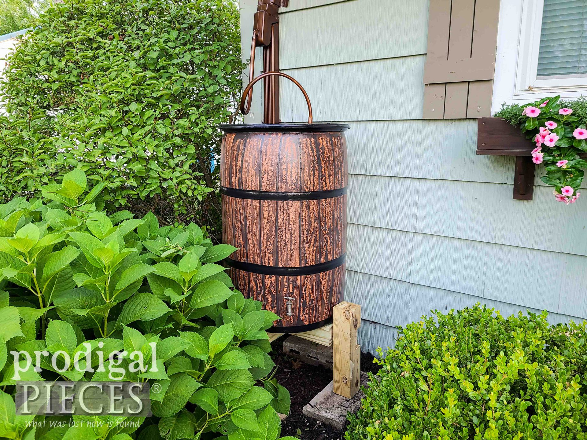 Handmade Rain Barrel from Upcycled Drum by Larissa of Prodigal Pieces | prodigalpieces.com #prodigalpieces #diy #garden #selfsufficient #homesteading
