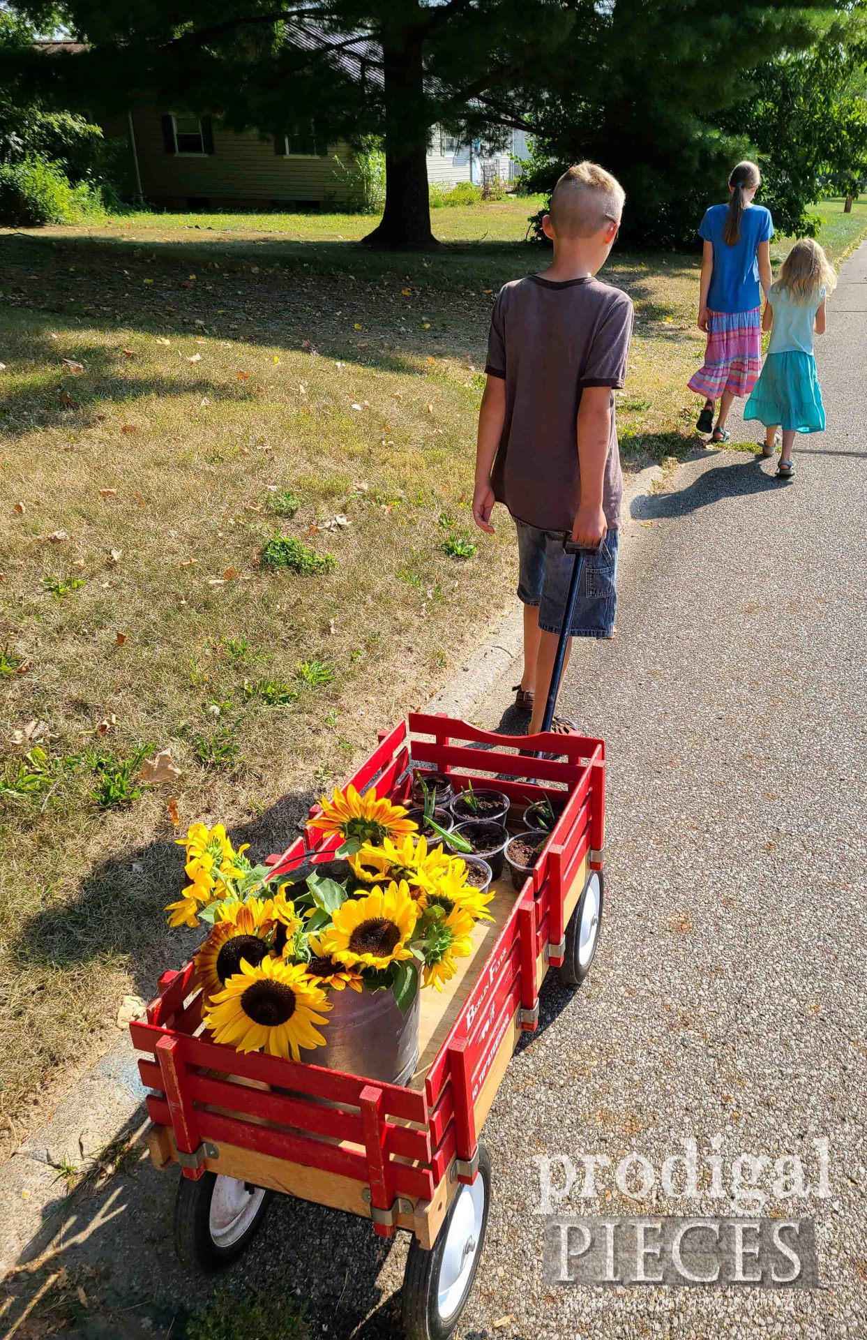 Wagon of Flowers and Succulents by Larissa of Prodigal Pieces | prodigalpieces.com #prodigalpieces #gardening #encouragement