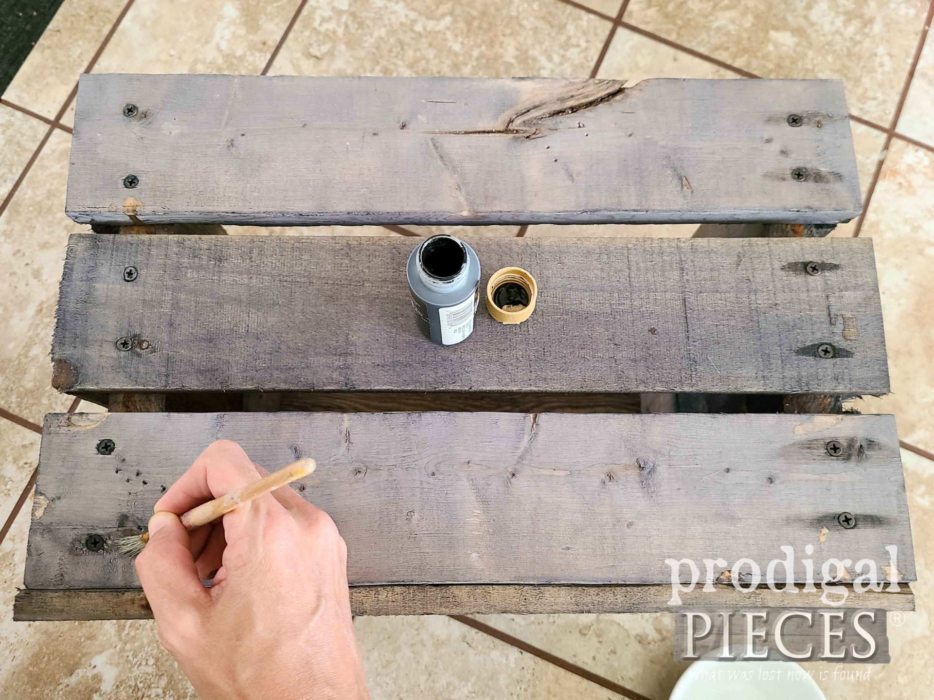 Applying Paint to Crate for Aged Effect by Prodigal Pieces | prodigalpieces.com #prodigalpieces