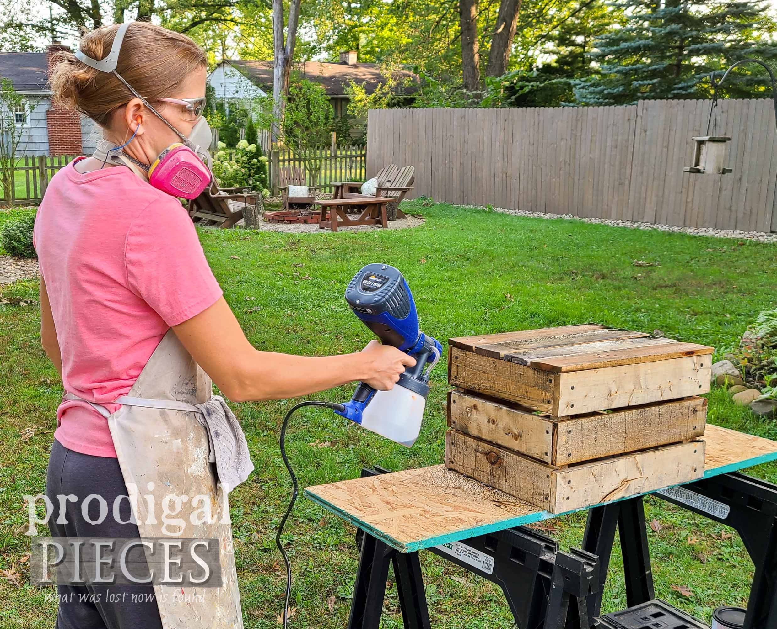 Larissa of Prodigal Pieces Spraying Crate with Weathered Wood Stain for Aged Appeal | Prodigal Pieces | prodigalpieces.com #prodigalpieces #diy #tools