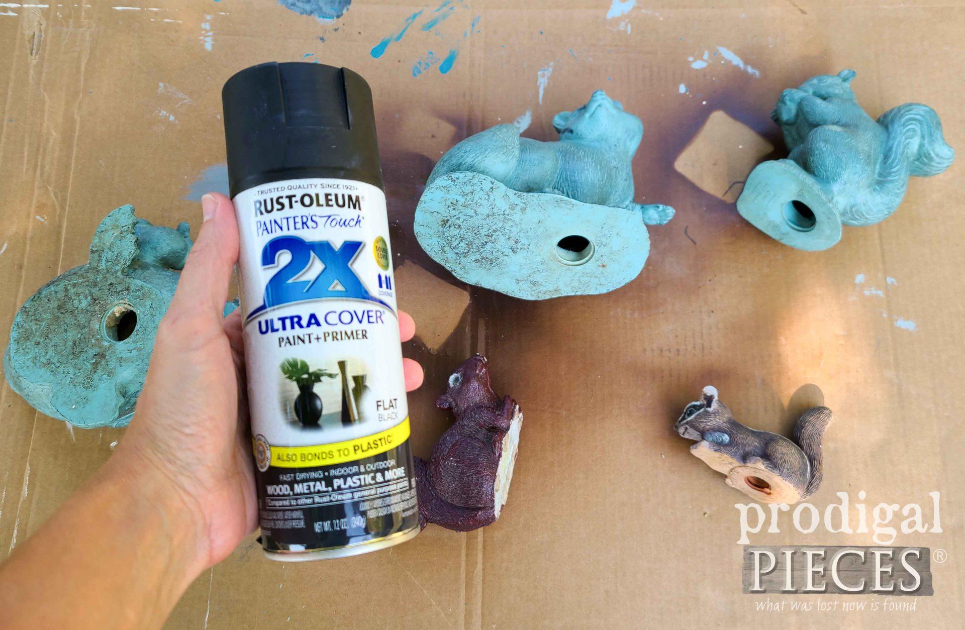 Spray Painting Upcycled Doorstops | prodigalpieces.com