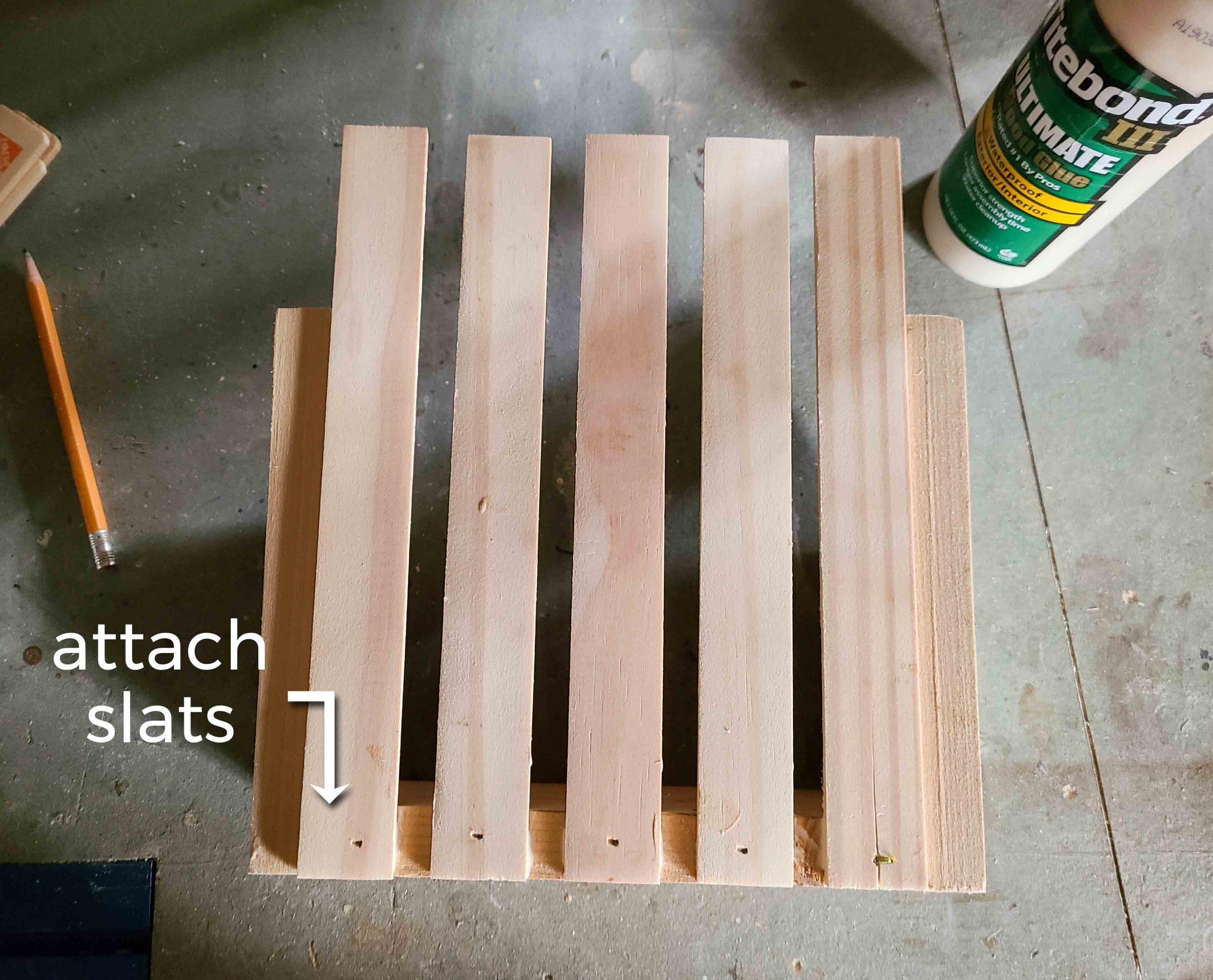 Attaching Stir Stick Slats to DIY Wall Pocket | prodigalpieces.com #prodigalpieces