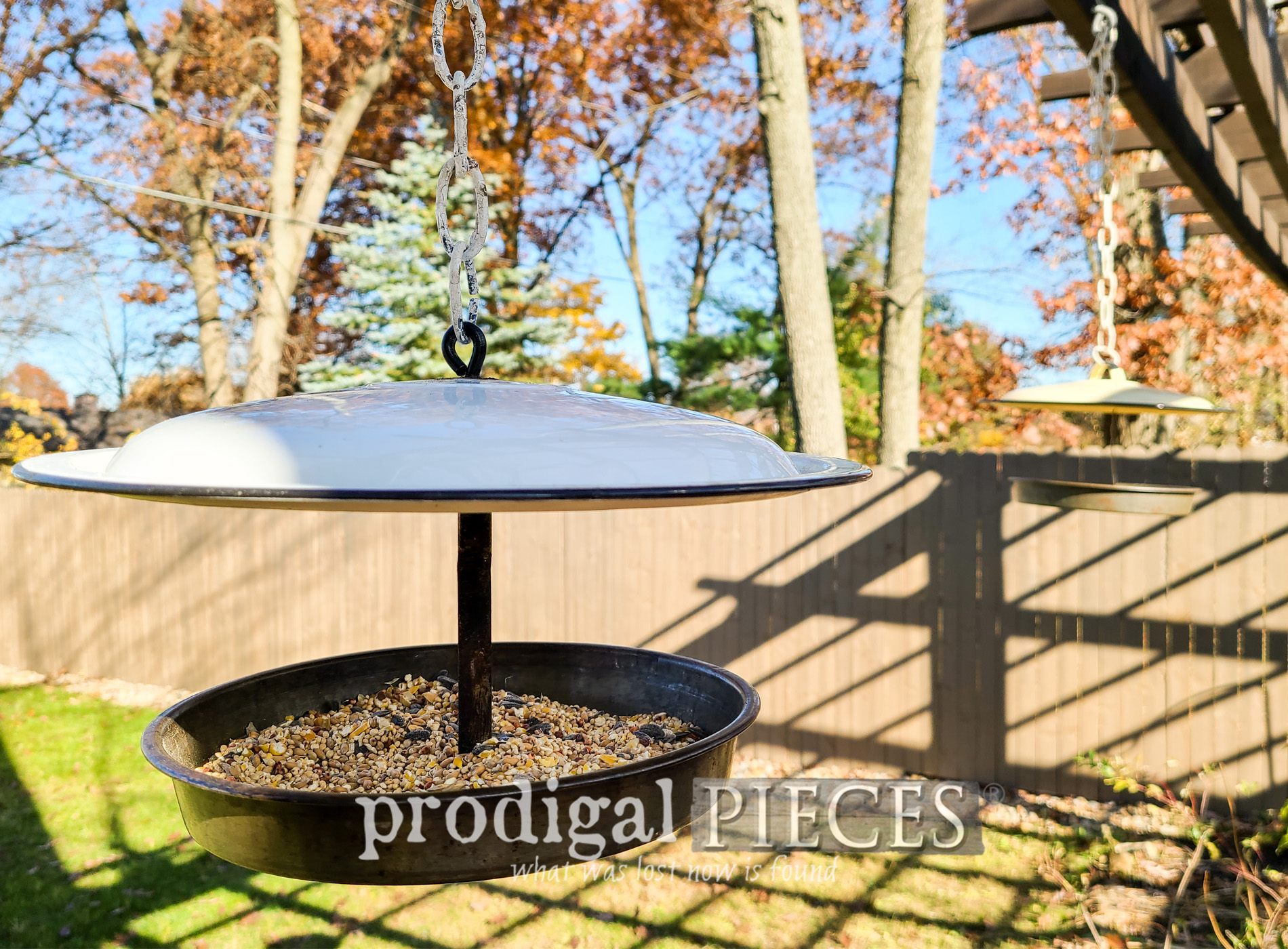 Featured Upcycled Bird Feeder from Enamel Pot Lids by Larissa of Prodigal Pieces | prodigalpieces.com #prodigalpieces #nature #birdfeeder #upcycle #gardening