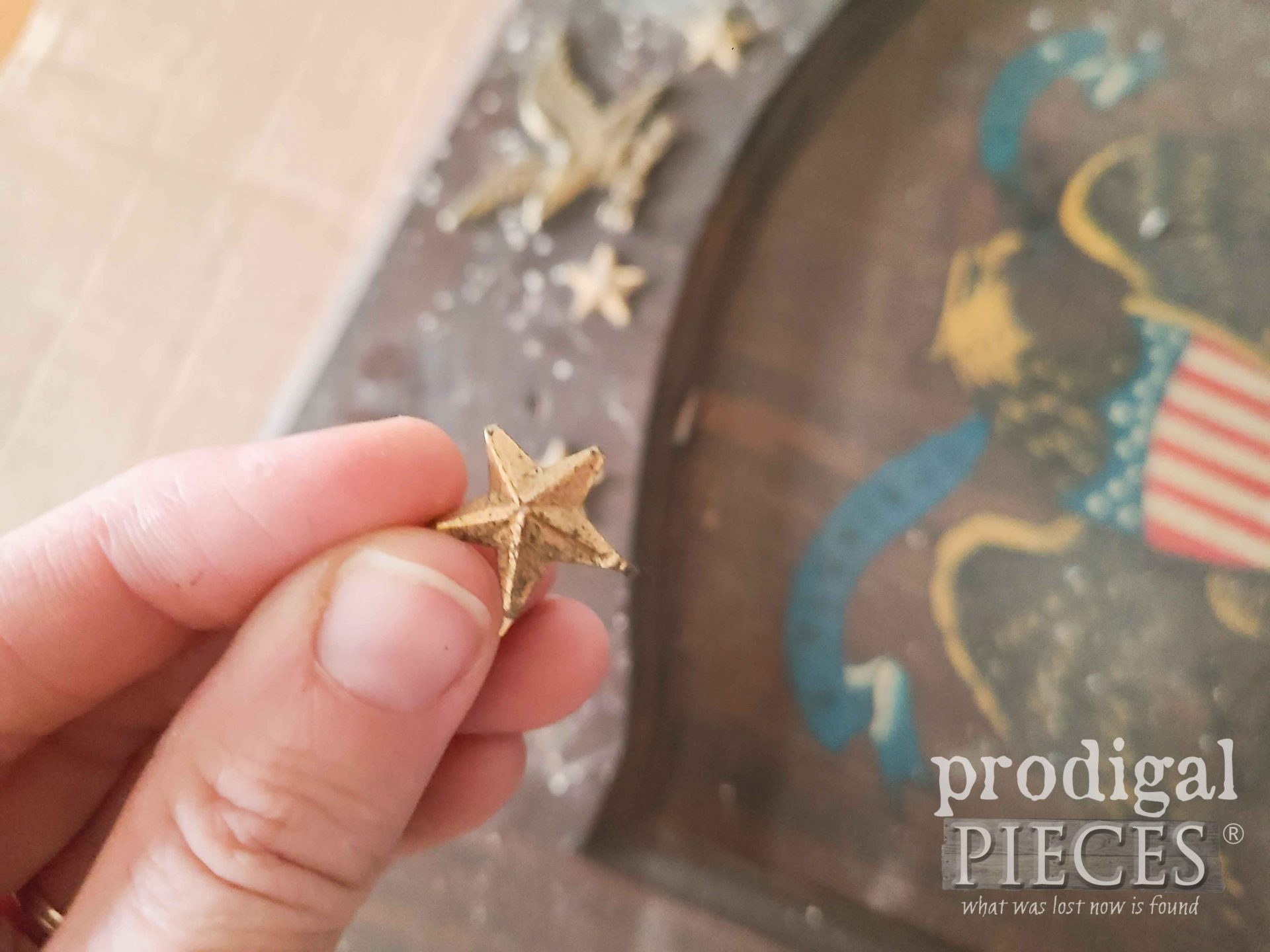 Removing Metal Stars from Farmhouse Oil Lamp Cupboard Door | prodigalpieces.com