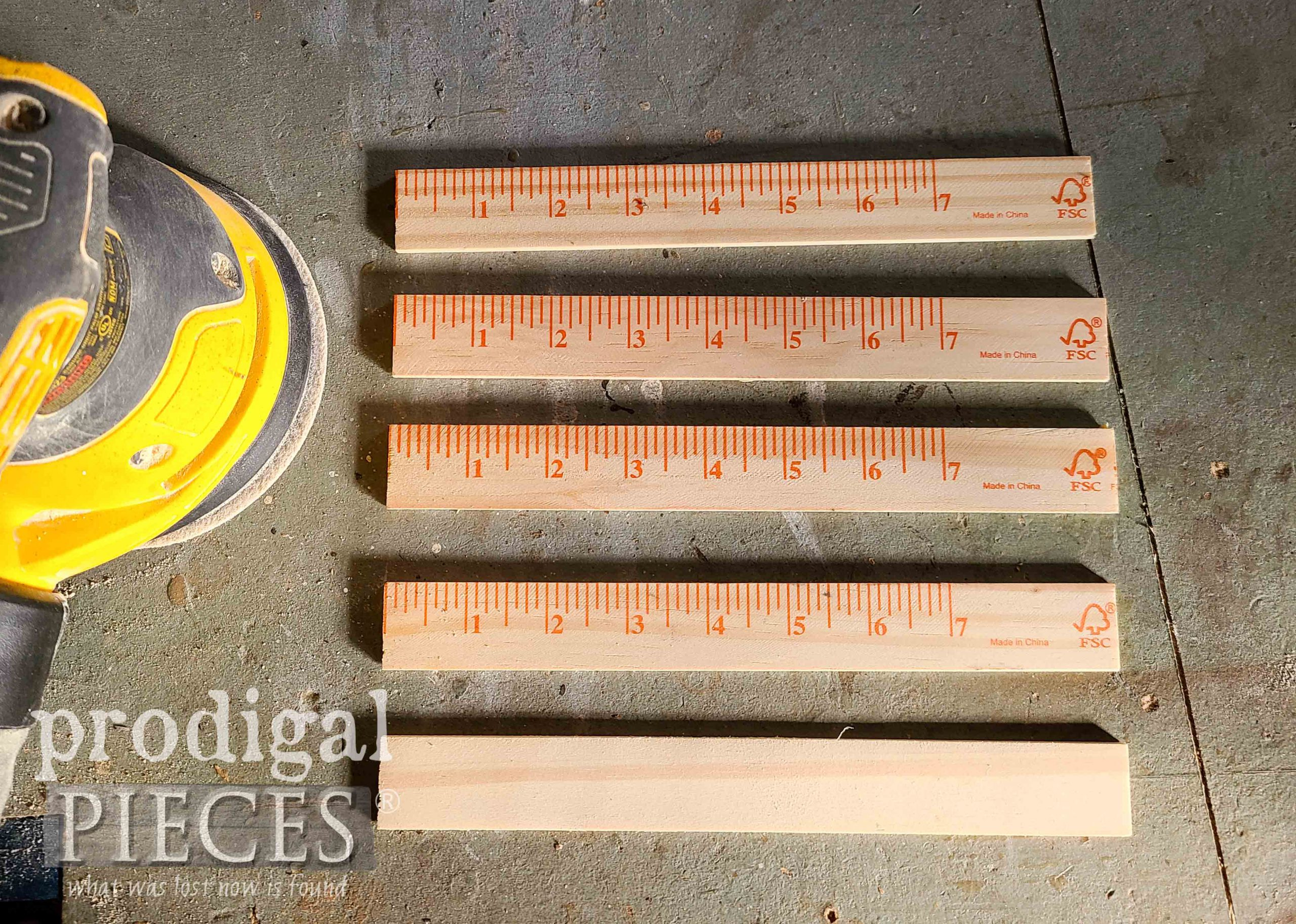 Sanding Paint Stir Sticks for DIY Wall Pocket by Larissa of Prodigal Pieces | prodigalpieces.com #prodigalpieces