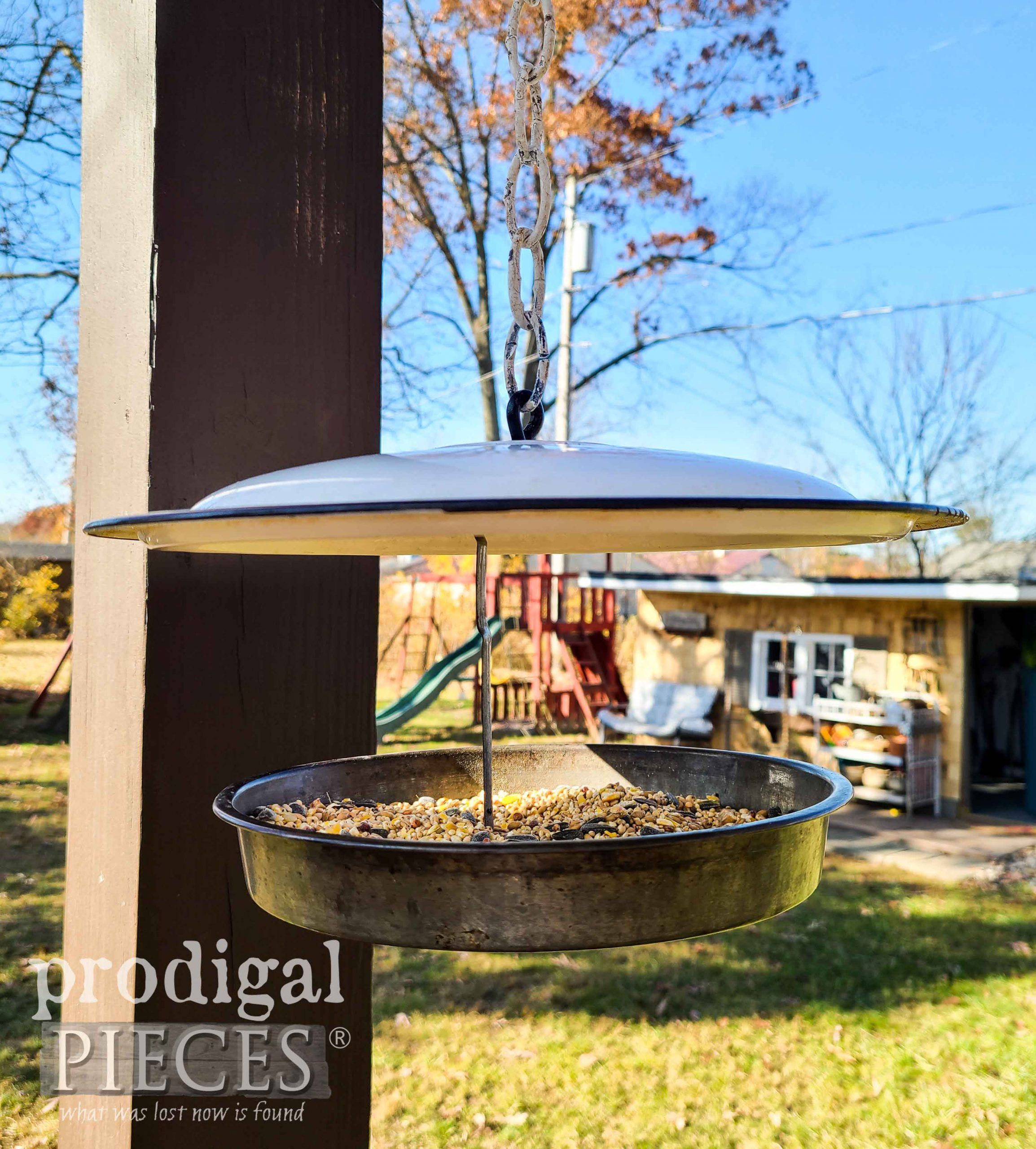 White Enamel Pot Lid Upcycled Bird Feeder by Larissa of Prodigal Pieces | prodigalpieces.com #prodigalpieces #garden #birdfeeder #home #diy