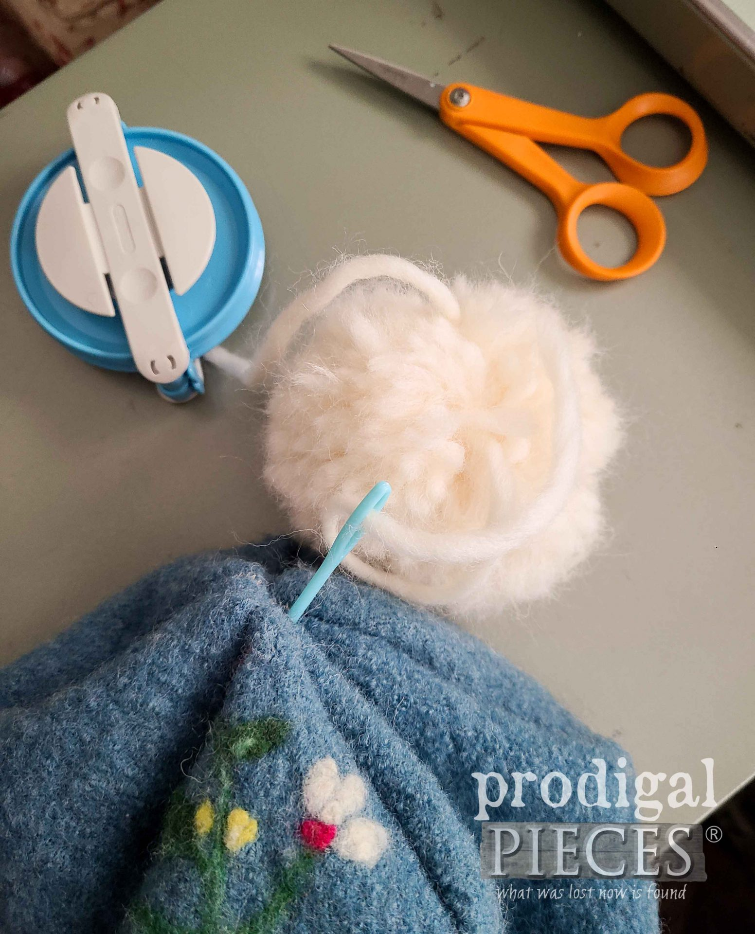 Attaching Wool Pom-Pom to Felted Wool Hat by Prodigal Pieces | prodigalpieces.com