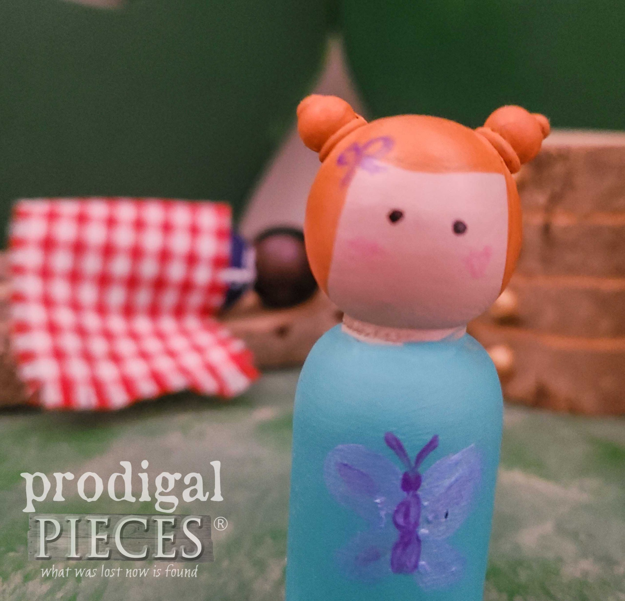 Girl Peg Doll with Buns by Larissa of Prodigal Pieces | prodigalpieces.com #prodigalpieces #handmade #dolls #play #kids