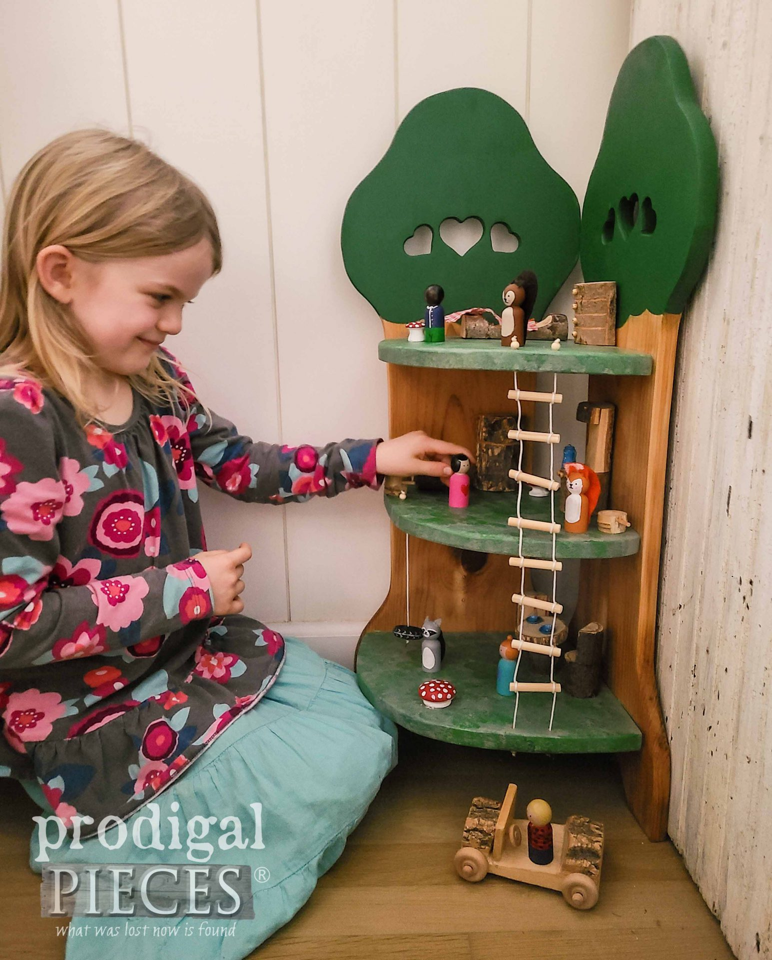 Kid Playing with Woodland Treehouse made from Upcycled Quilt Rack by Larissa of Prodigal Pieces | prodigalpieces.com #prodigalpieces #handmade #toys #kids #gift