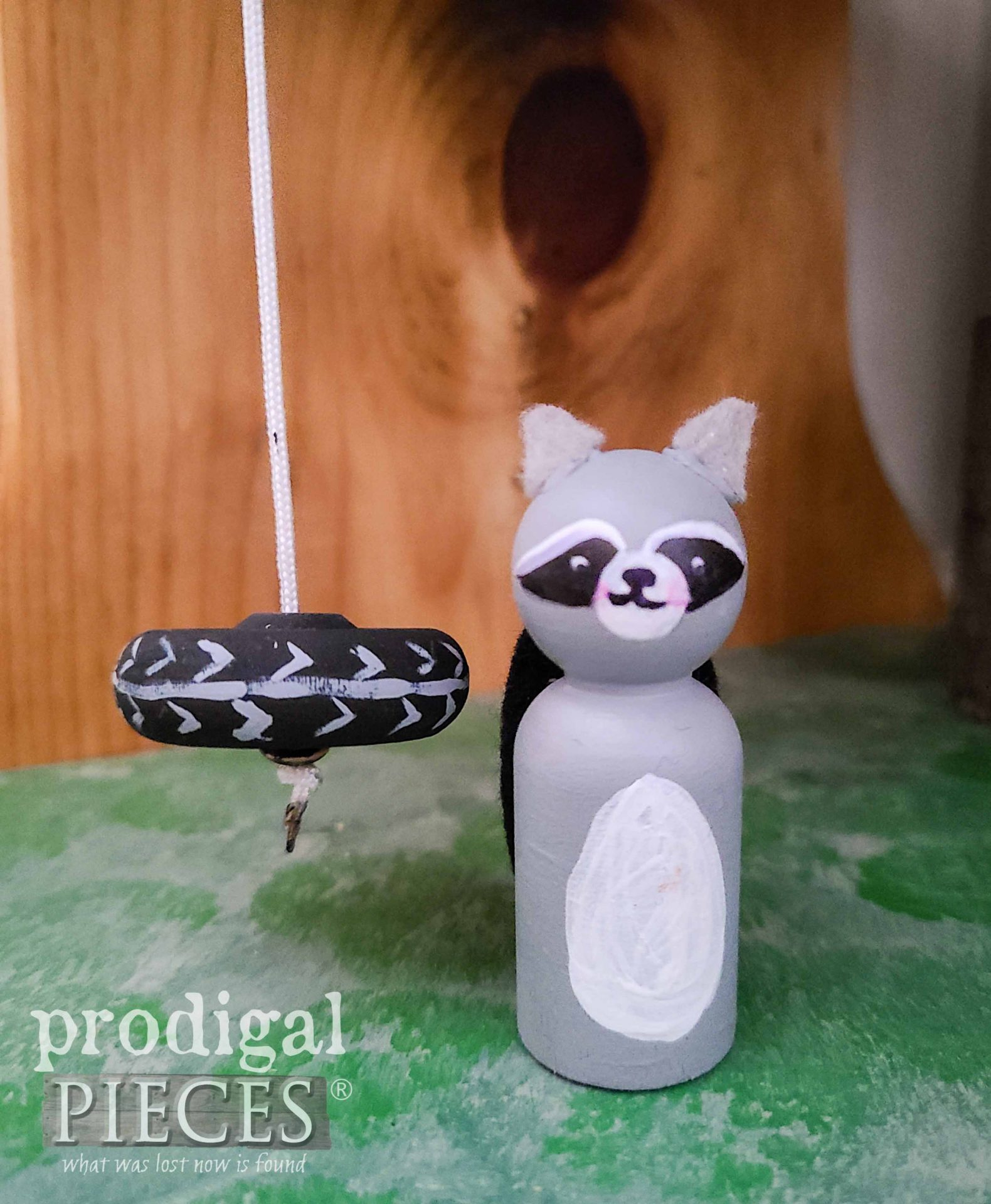 Treehouse Tire Swing with Woodland Raccoon Peg doll by Larissa of Prodigal Pieces | prodigalpieces.com #prodigalpieces #toys #doll #kids #handmade