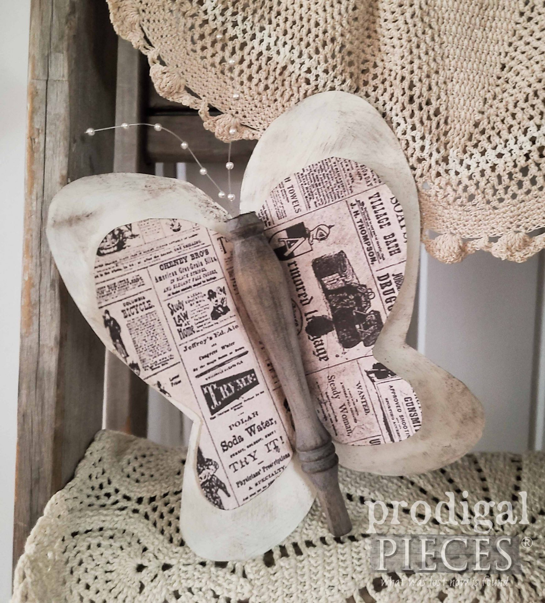 Newspaper Spindle Butterfly by Larissa of Prodigal Pieces | prodigalpieces.com #prodigalpieces