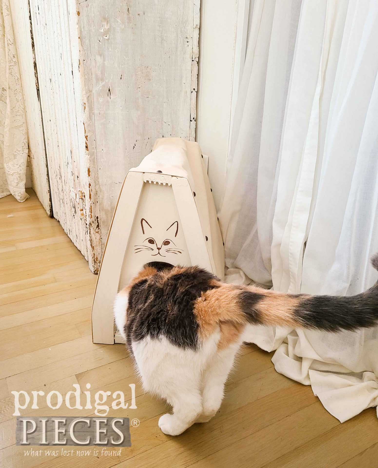 Calico Kitty Cat Cave by Larissa of Prodigal Pieces from Upcycle Chair Parts | prodigalpieces.com #prodigalpieces #diy #cats #home #homedecor