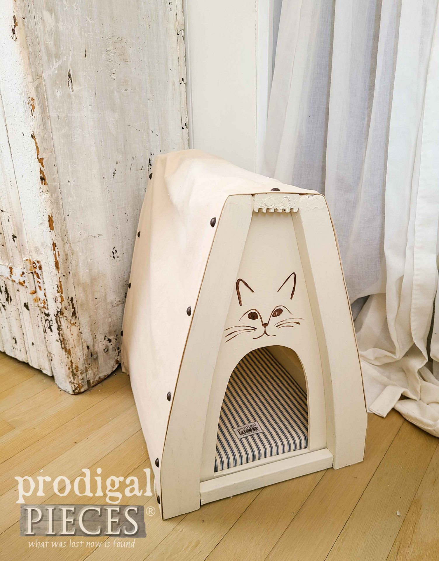 Farmhouse Style Cat Cave Made Out of Upcycled Chair Parts by Larissa of Prodigal Pieces with Ticking Stripe Mattress | prodigalpieces.com #prodigalpieces #diy #farmhouse