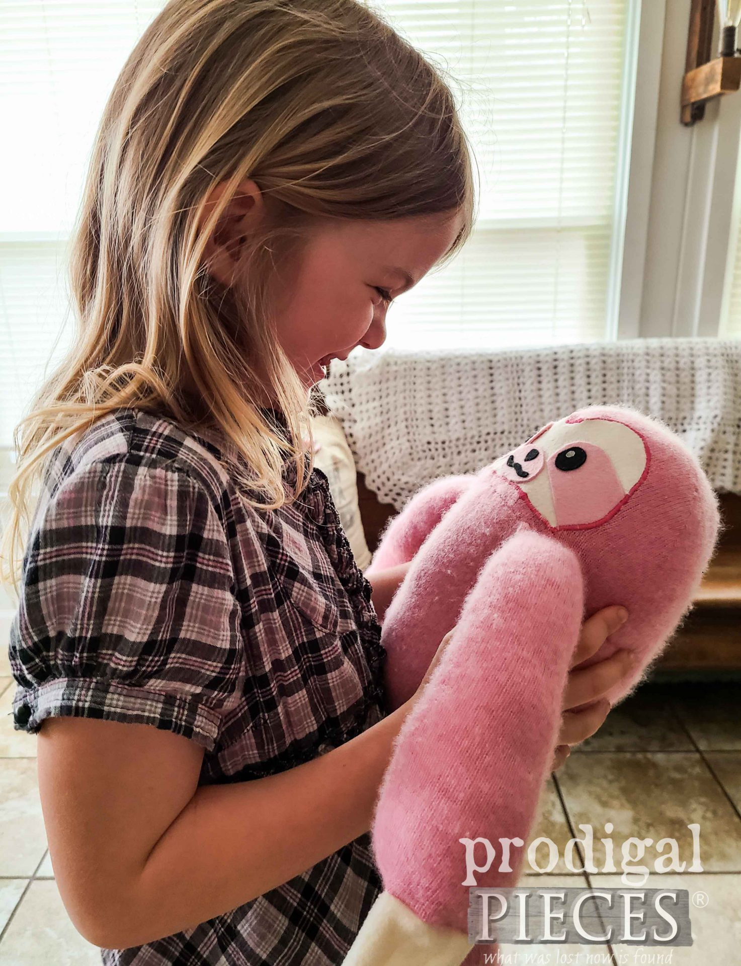 Young Girl with Upcycled Sweater Sloth Plush Toy by Larissa of Prodigal Pieces | prodigalpieces.com #prodigalpieces #toy #kids #refashion #upcycled