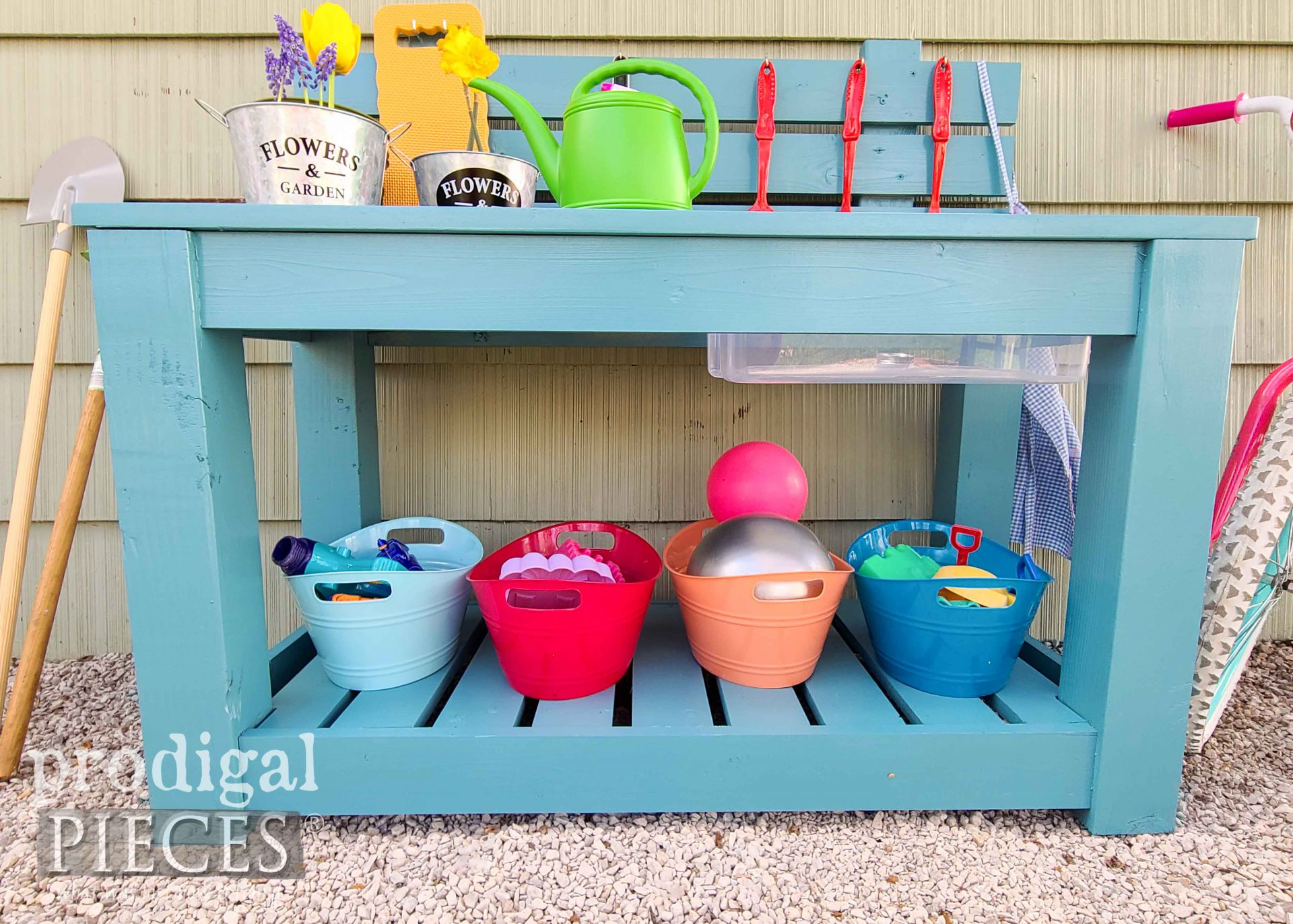 Bottom Shelf of Upcycled Mud Bar Built by JC & Larissa of Prodigal Pieces | prodigalpieces.com #prodigalpieces #pretendplay #kids #toys #woodworking