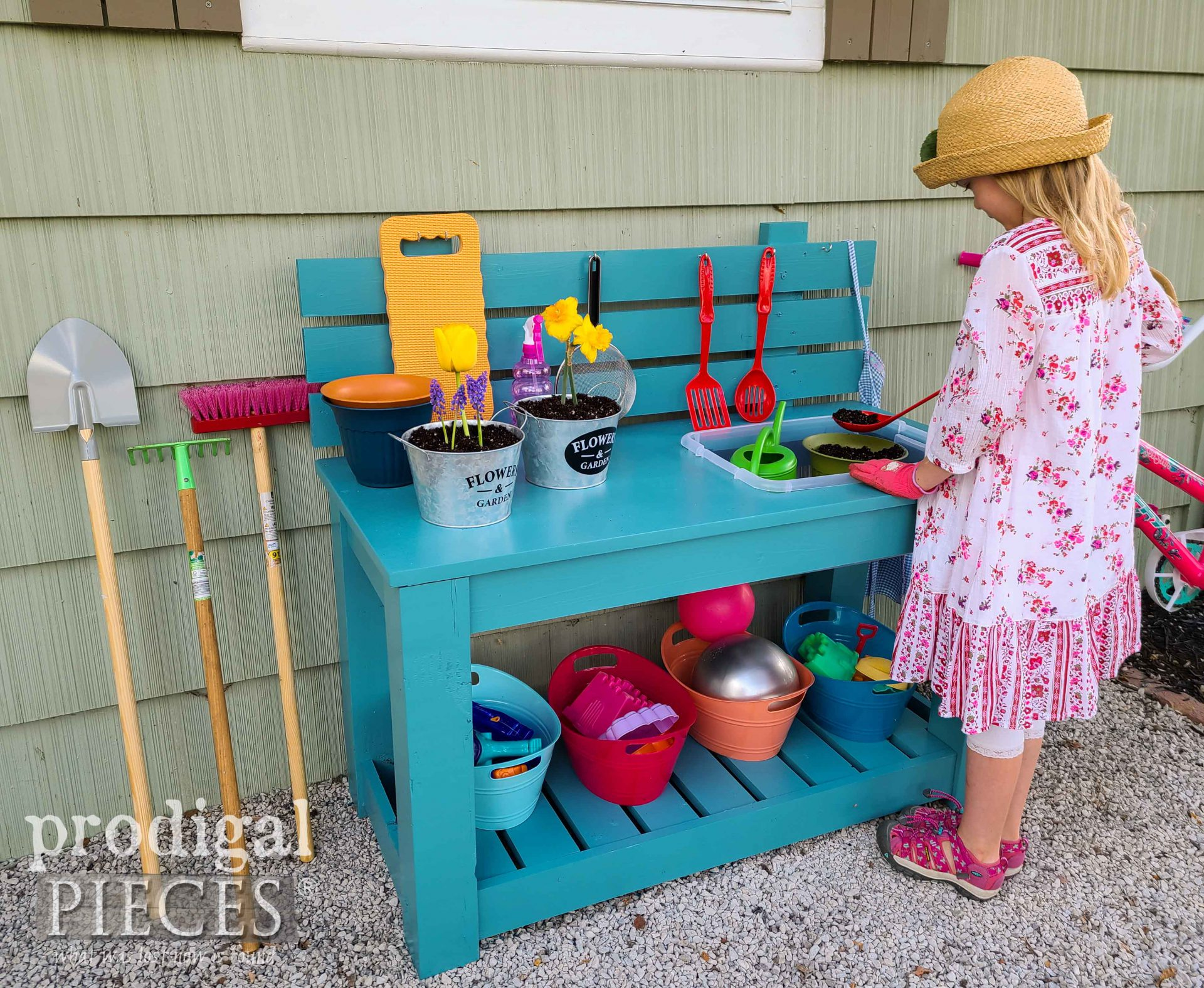 Kids Potting Bench from Upcycled Sewing Desk Top by JC & Larissa Haynes of Prodigal Pieces | prodigalpieces.com #prodigalpieces #diy #upcycled #garden #toys