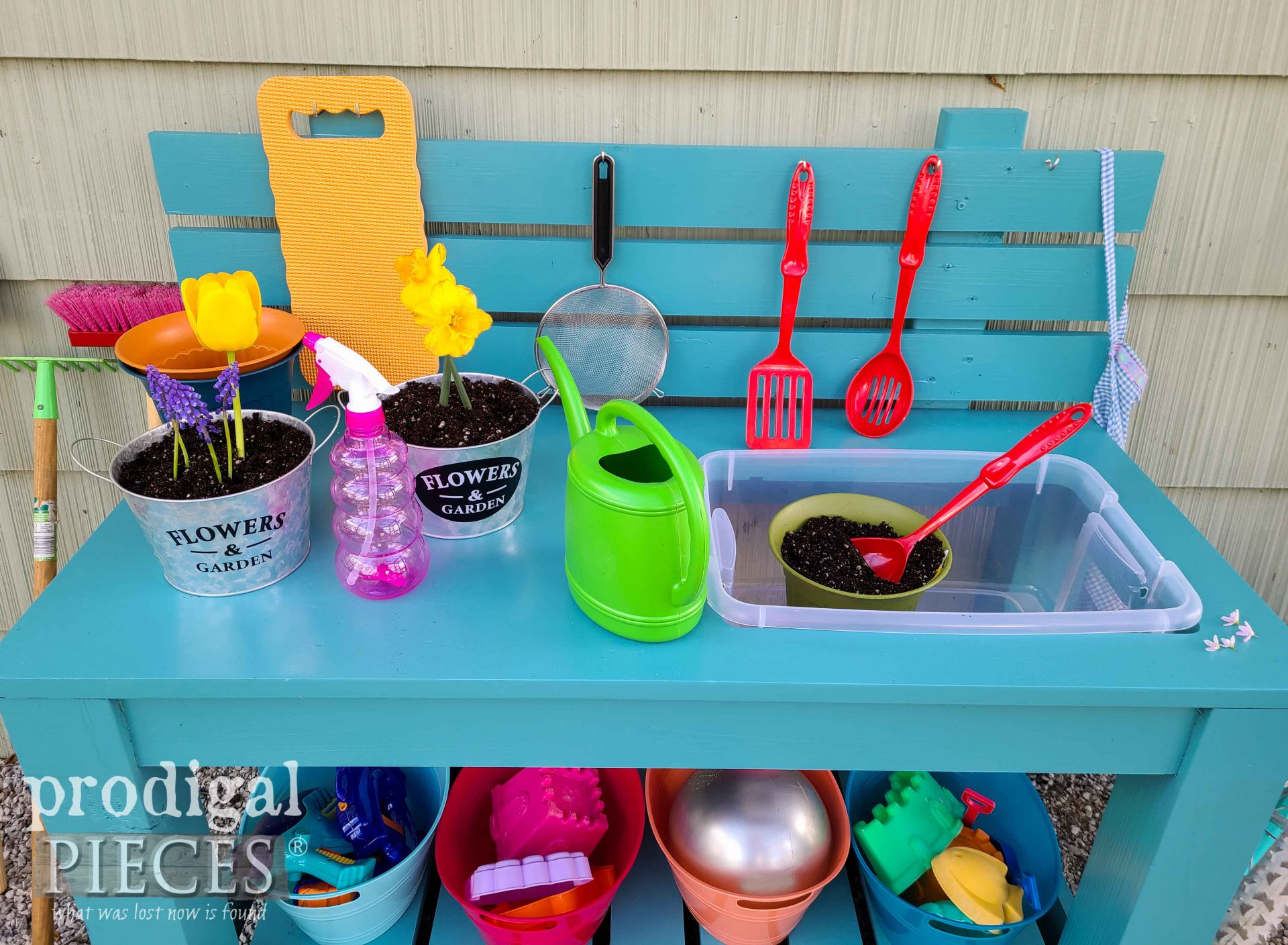 Upcycled Mud Bar Top with Fun Tools by Larissa & JC of Prodigal Pieces | prodigalpieces.com #prodigalpieces #upcycled #toys #garden #summer