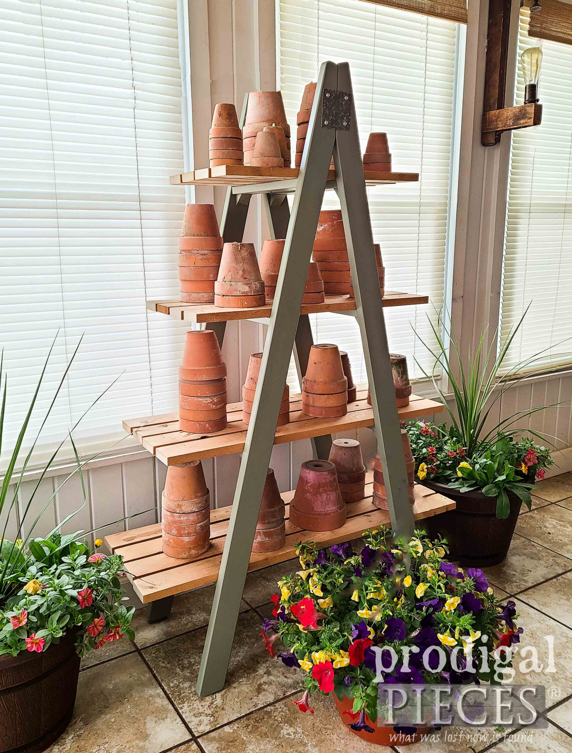 DIY Tiered Ladder Shelf Made from Reclaimed Materials and Upcycled Bunk Bed Ladder by Larissa of Prodigal Pieces | prodigalpieces.com #prodigalpieces #garden #farmhouse #home #homedecor