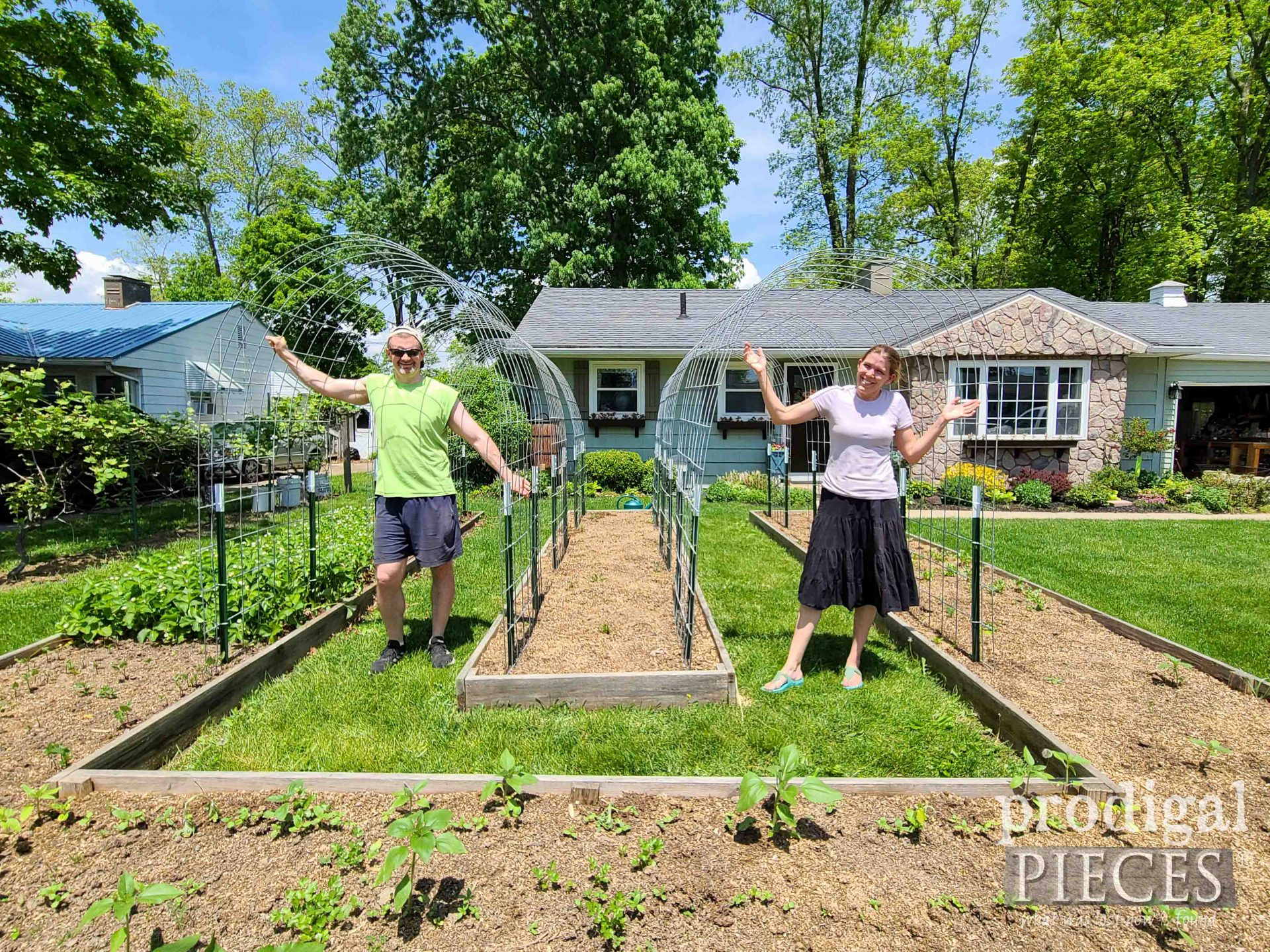 JC & Larissa of Prodigal Pieces with Finished Arched Garden Trellis | prodigalpieces.com #prodigalpieces