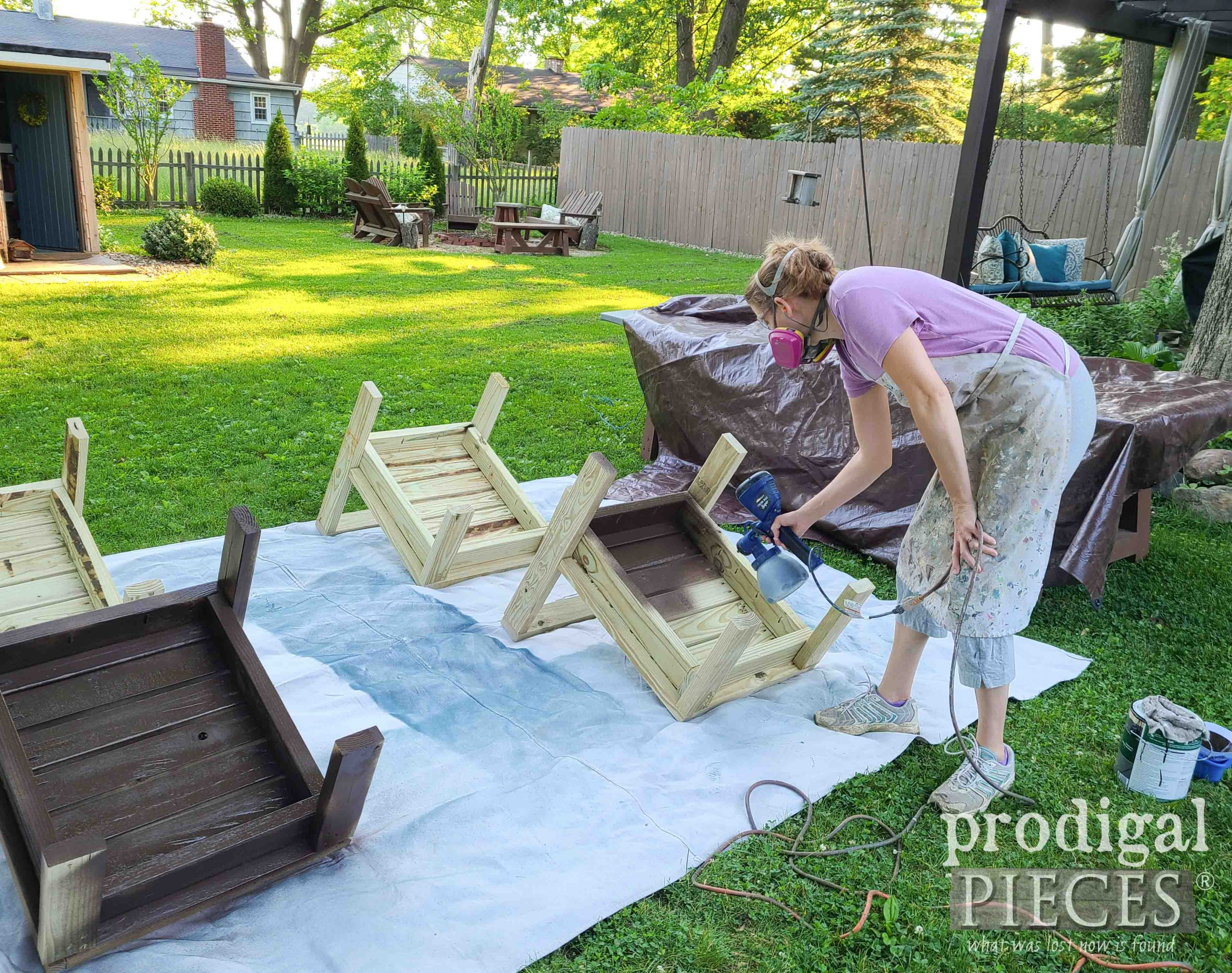 Spraying Patio Sectional with Stain by Larissa of Prodigal Pieces | prodigalpieces.com #prodigalpieces #homeright #diy